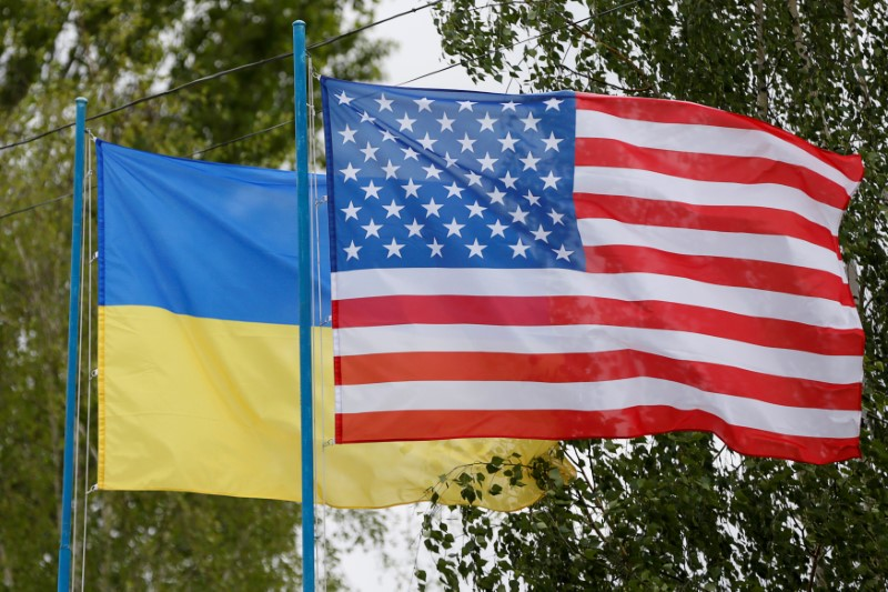 National flags of Ukraine and the U.S. fly at a compound of a police training base outside Kiev, Ukraine, May 6, 2016. REUTERS/Valentyn Ogirenko