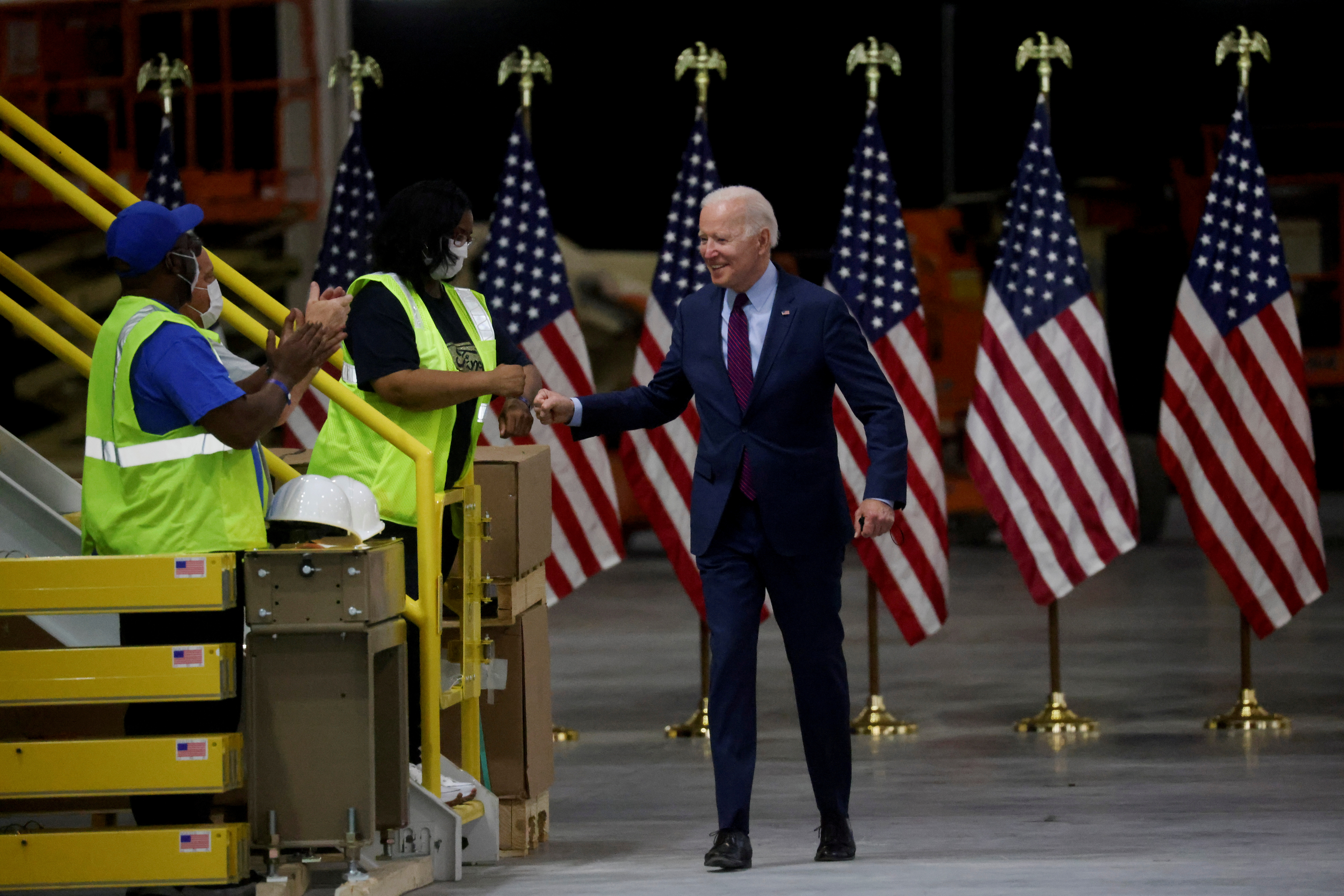 U.S. President Joe Biden bumps fists with workers after touring Ford Rouge Electric Vehicle Center in Dearborn, Michigan, U.S., May 18, 2021.  REUTERS/Leah Millis