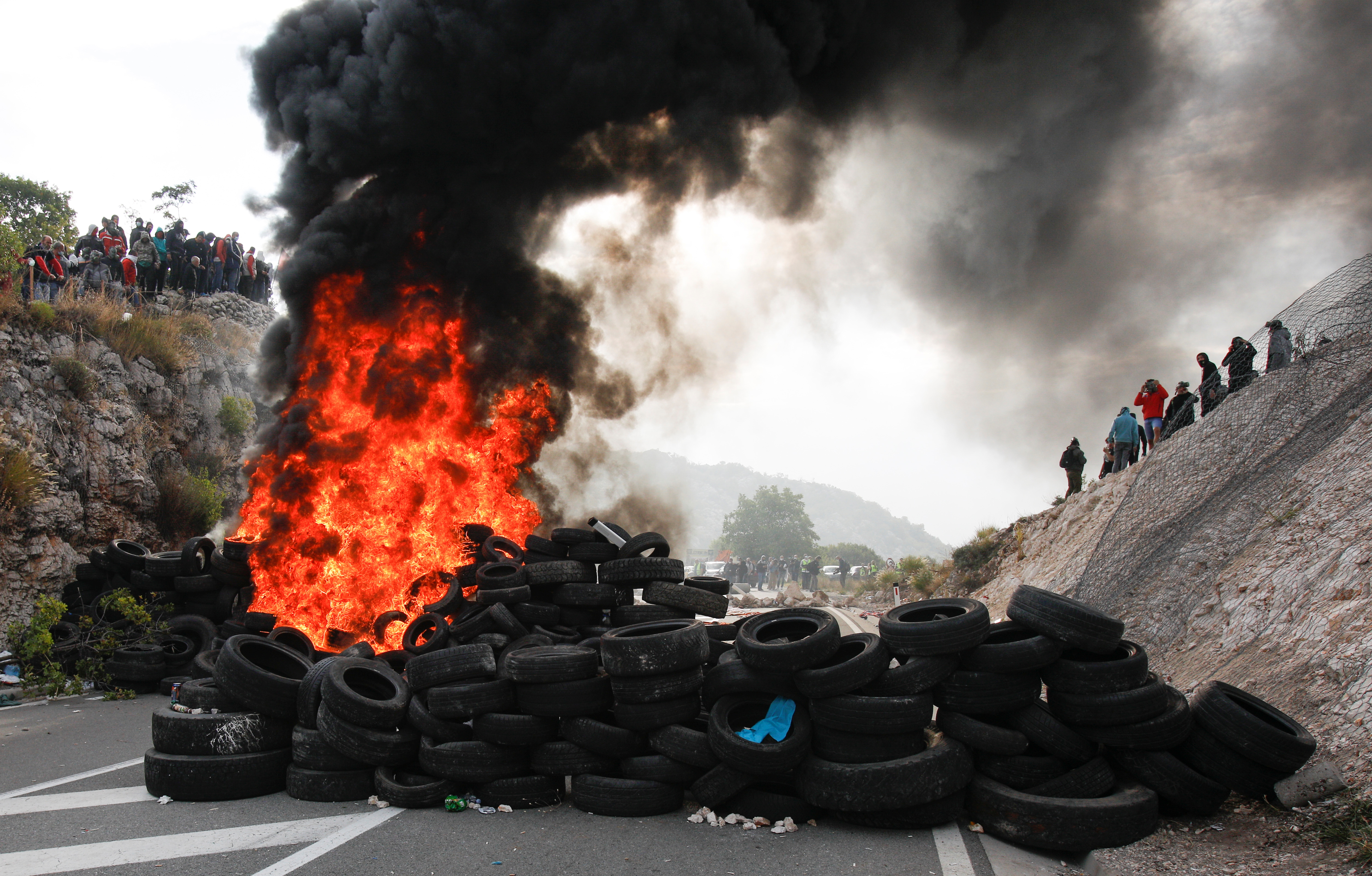 A barricade is set on fire during a protest against the enthronement of Bishop Joanikije in Cetinje, Montenegro, September 5, 2021. REUTERS/Stevo Vasiljevic