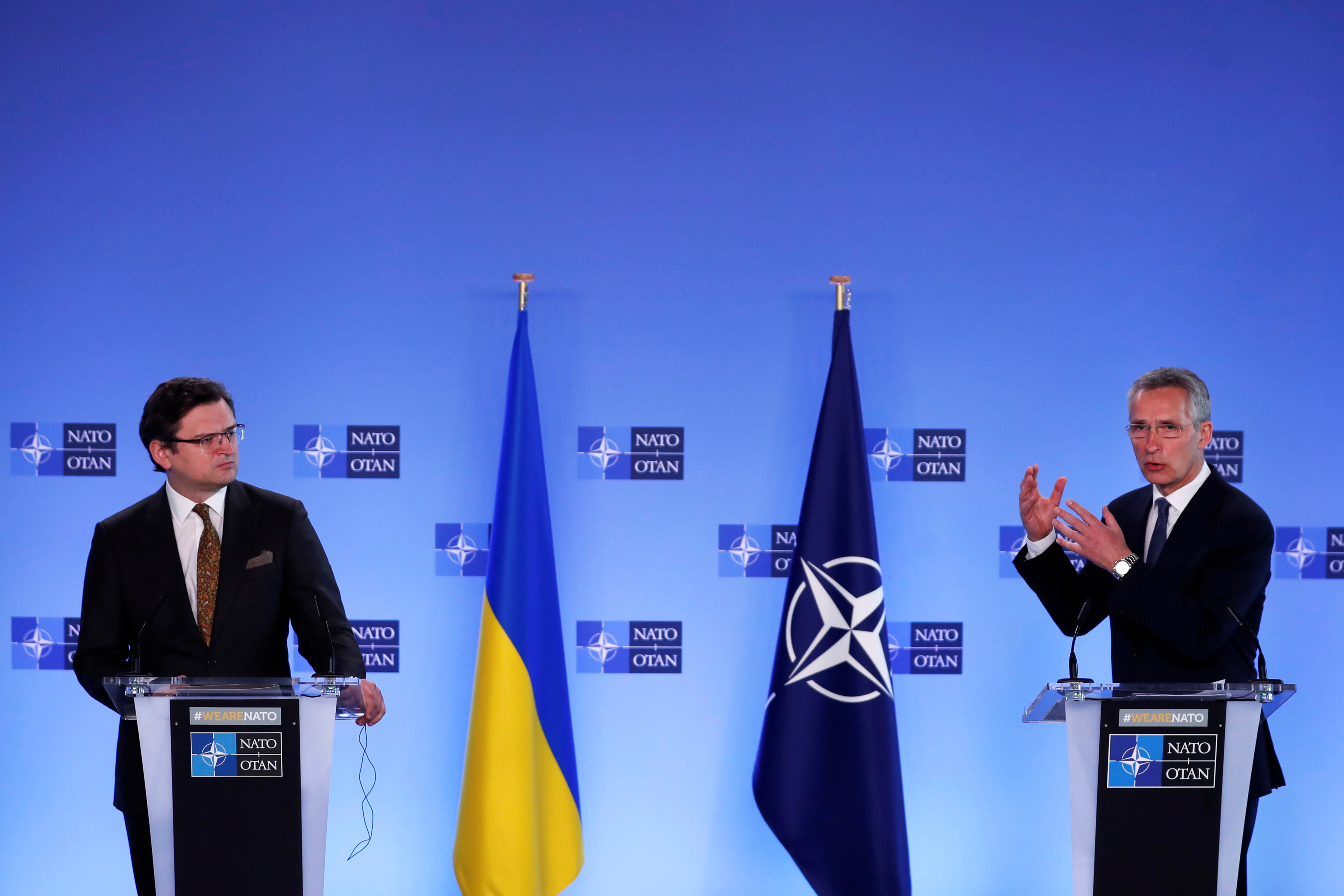 NATO Secretary General Jens Stoltenberg and Ukrainian Foreign Minister Dmytro Kuleba give a press conference in Brussels, Belgium, April 13, 2021. Francisco Seco/Pool via REUTERS
