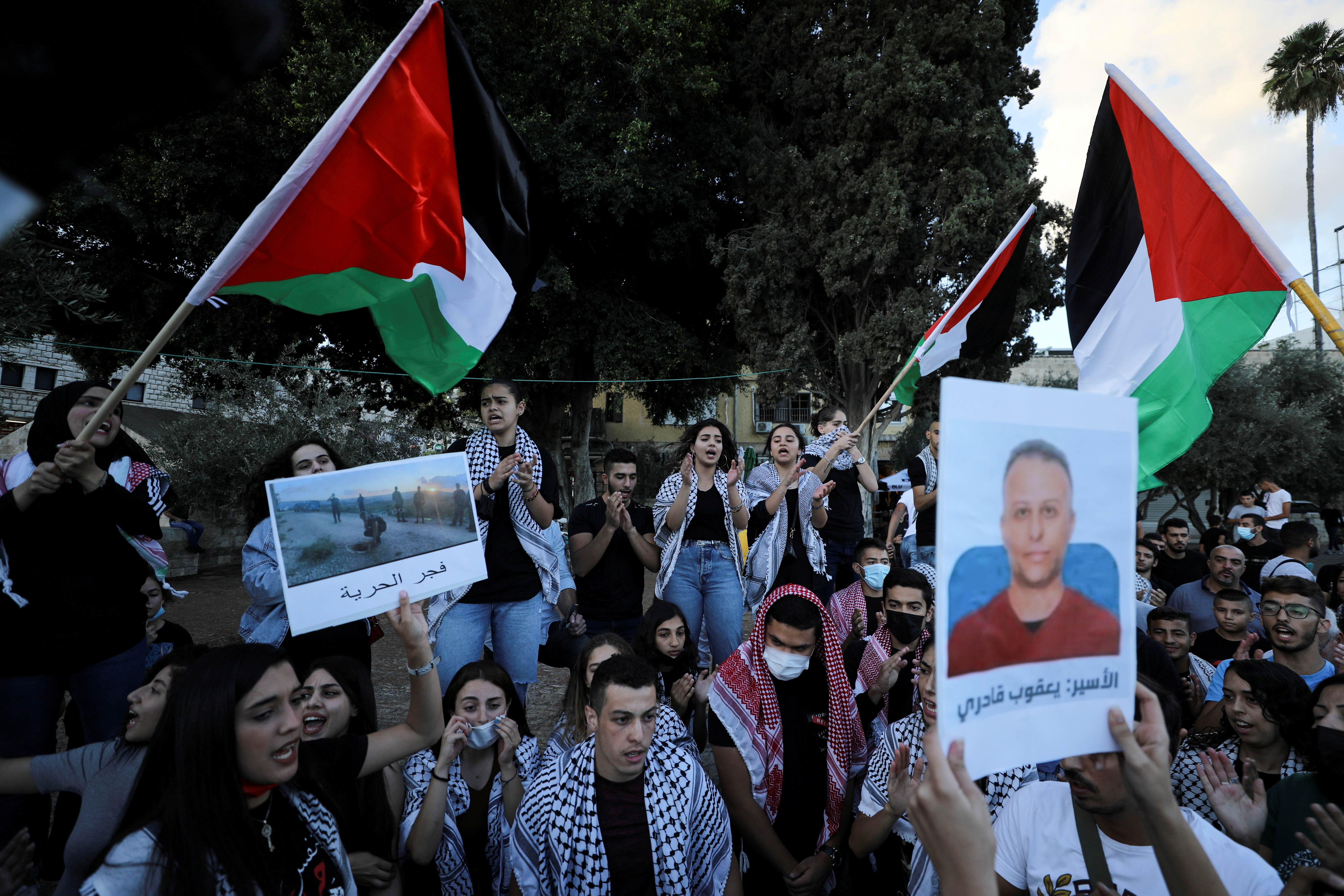 People take part in a protest as they support the six Palestinian militants men who had escaped from Gilboa prison earlier this week in Nazareth, Israel September 11, 2021. REUTERS/Ammar Awad/File Photo