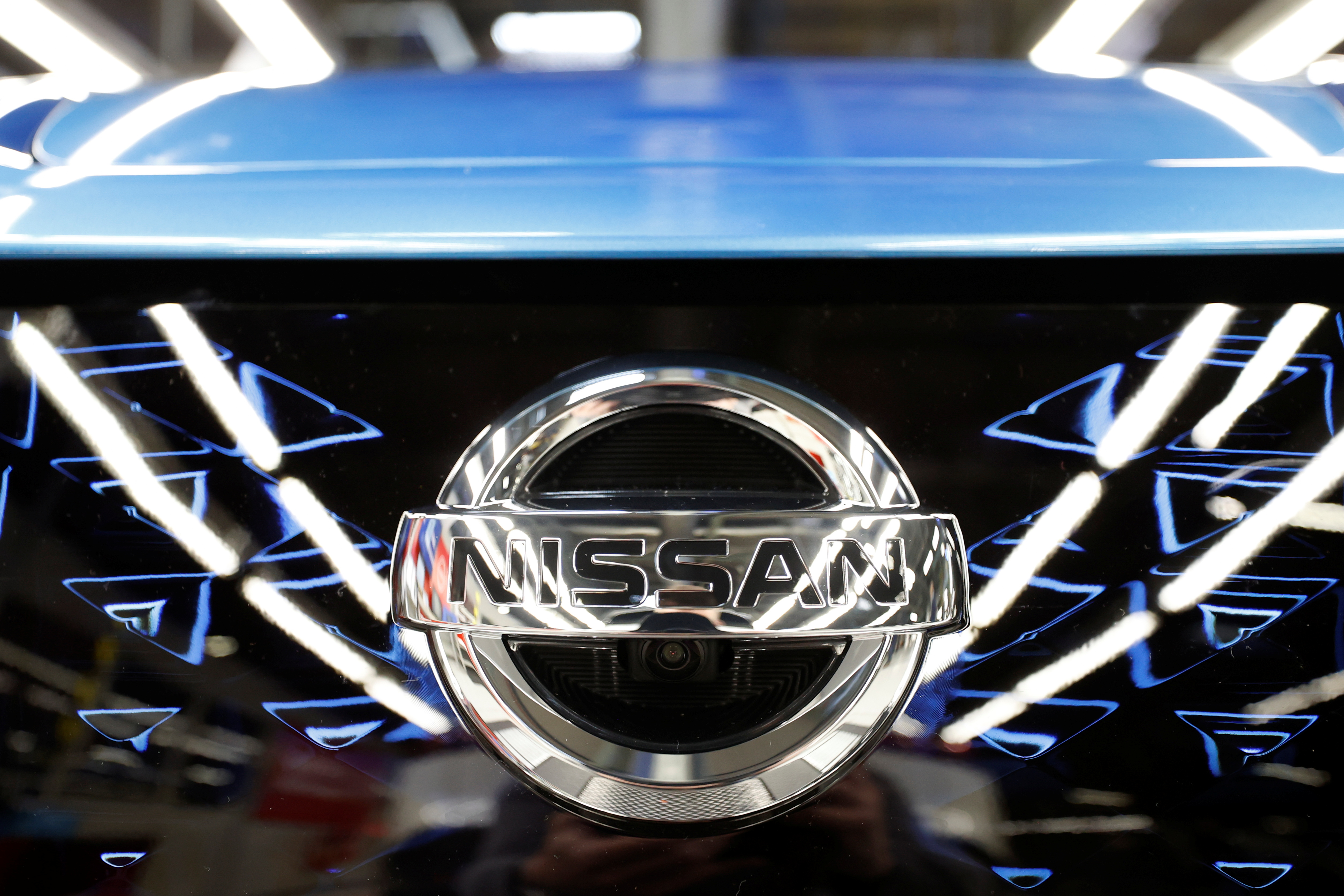 The logo of Nissan is seen on a car ahead of a news conference at Nissan's Sunderland plant in Sunderland, Britain, July 1, 2021. REUTERS/Phil Noble/Files