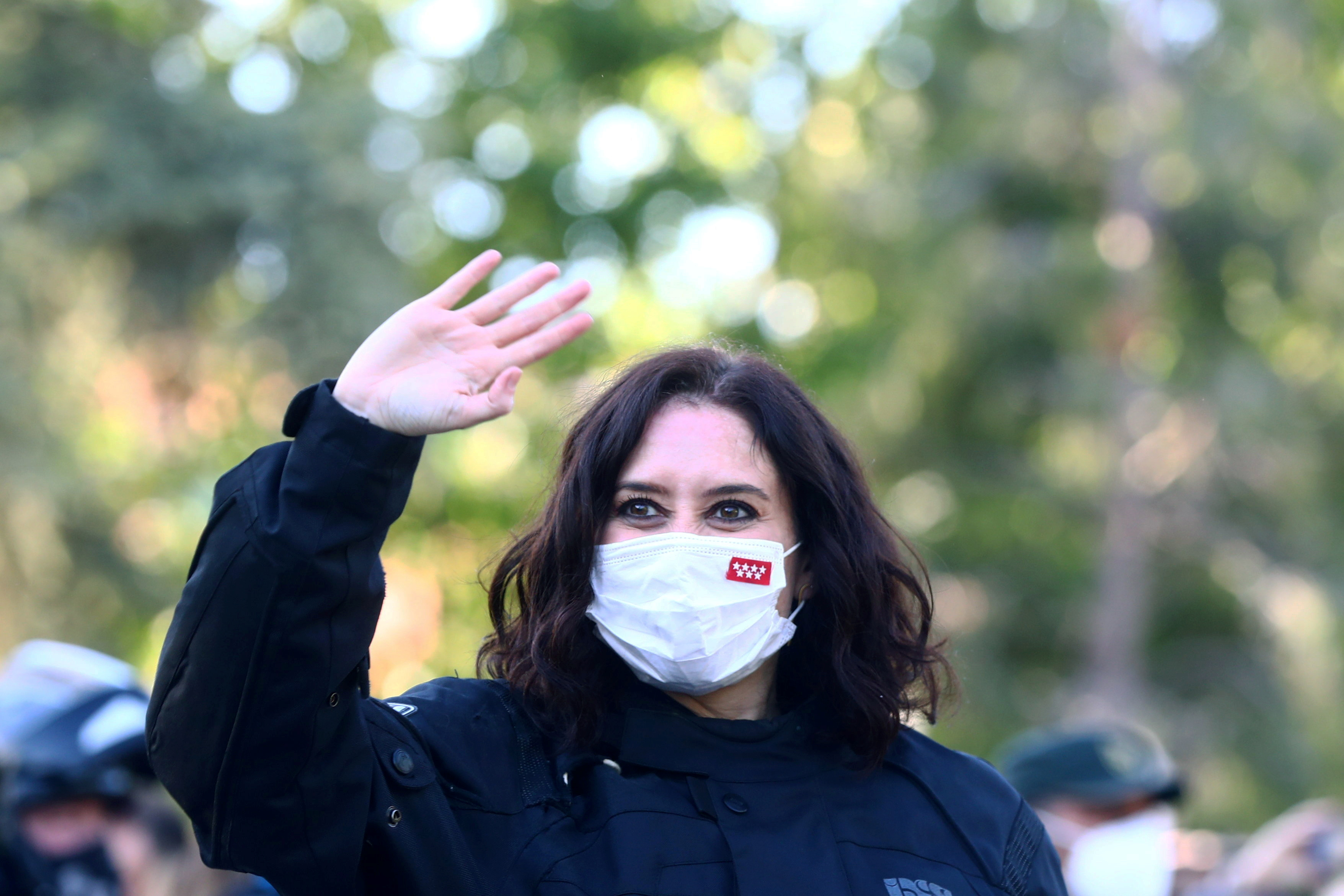 Madrid regional government leader Isabel Diaz Ayuso waves to supporters upon arriving to an electoral event ahead upcoming regional elections in Valdemoro, Spain, April 29, 2021. REUTERS/Sergio Perez