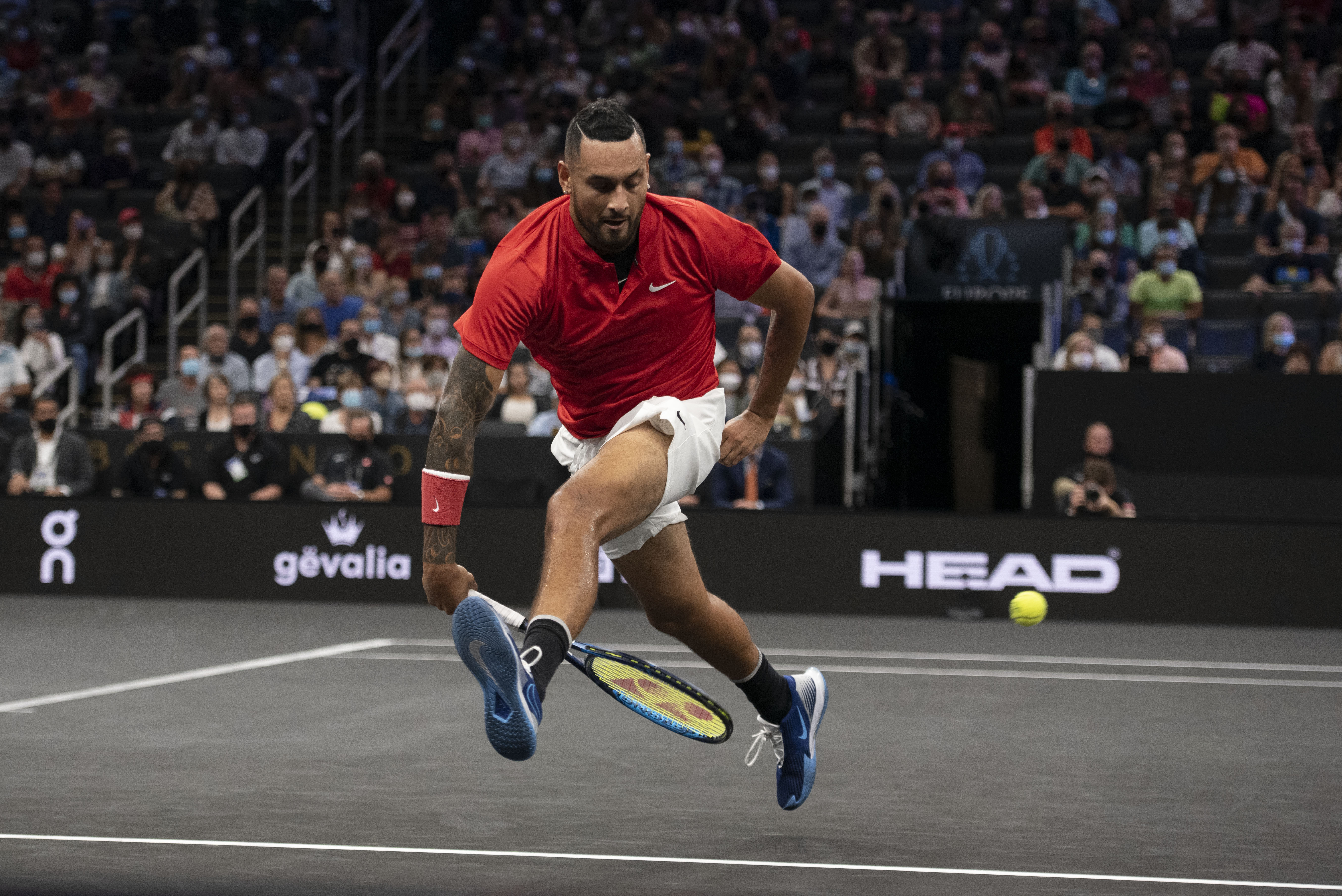 Sep 25, 2021; Boston, MA, USA;  Team World player Nick Kyrgios attempts a shot between his legs during the first set of his match against Team Europe player Stefanos Tsitsipas at TD Garden. Mandatory Credit: Richard Cashin-USA TODAY Sports/File Photo