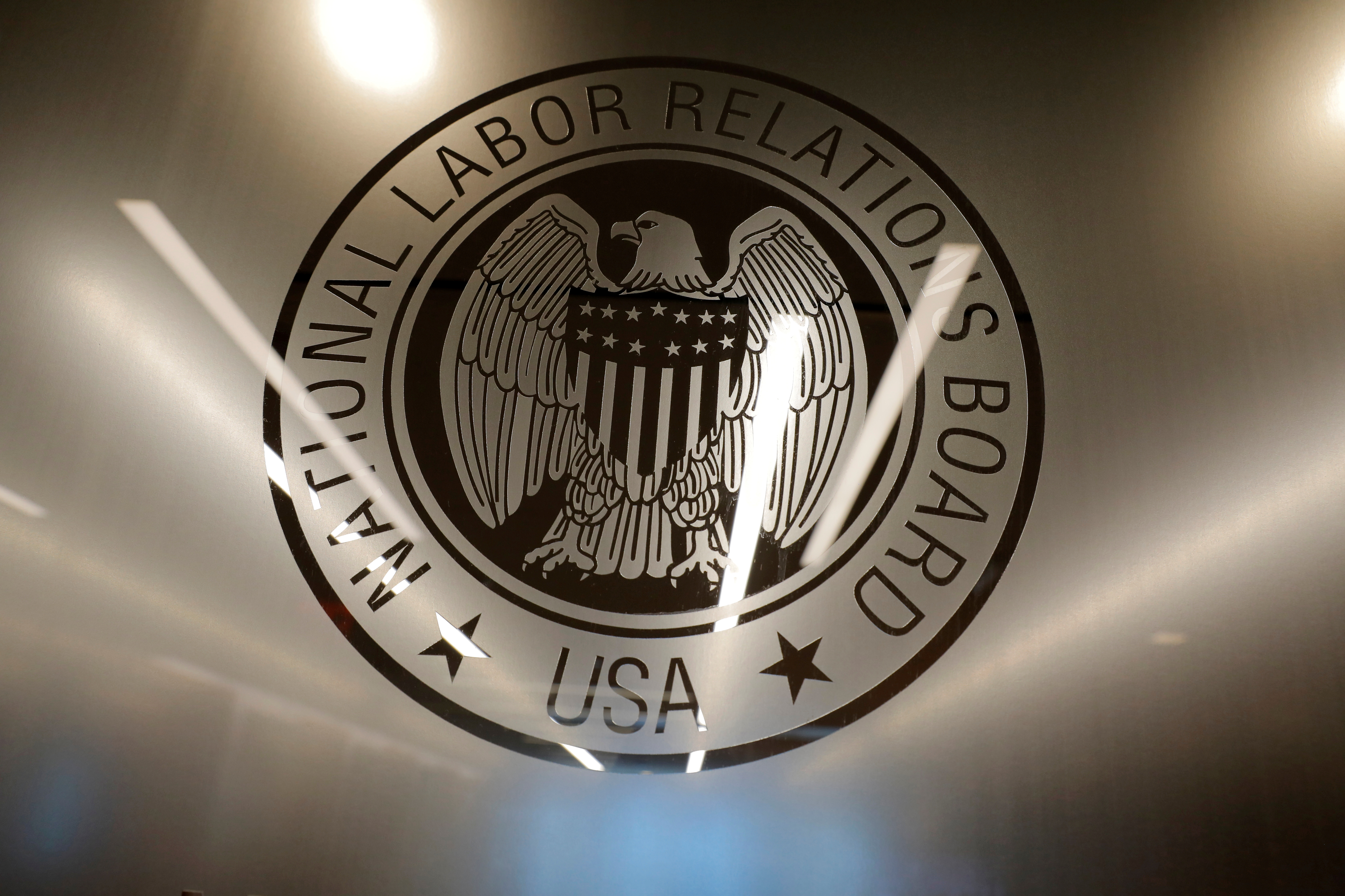 The seal of the National Labor Relations Board (NLRB) is seen at their headquarters in Washington, D.C., U.S., May 14, 2021. REUTERS/Andrew Kelly/File Photo