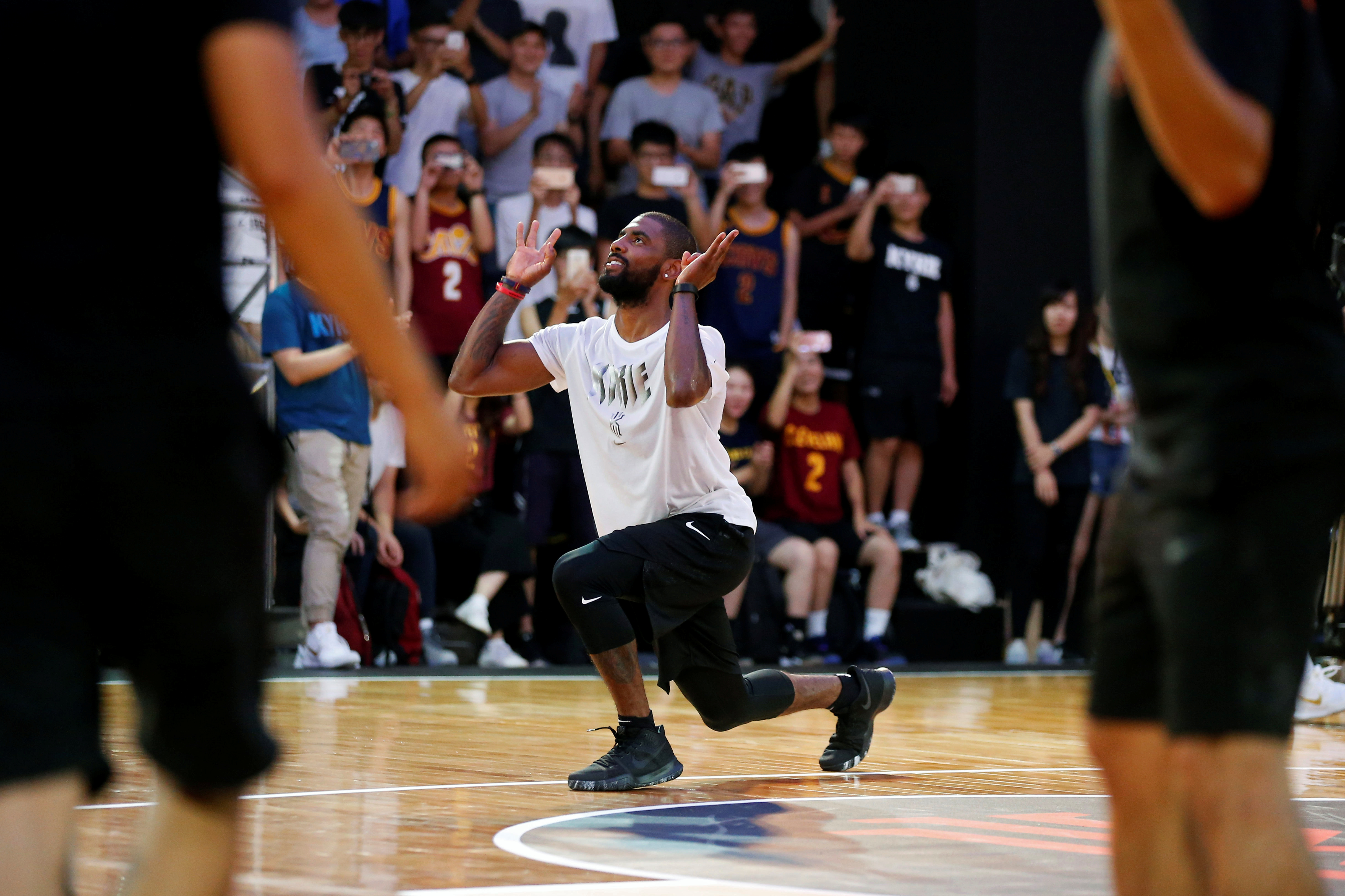 NBA player Kyrie Irving of the Cleveland Cavaliers, reacts during a promotional event in Taipei, Taiwan July 22, 2017. REUTERS/Tyrone Siu