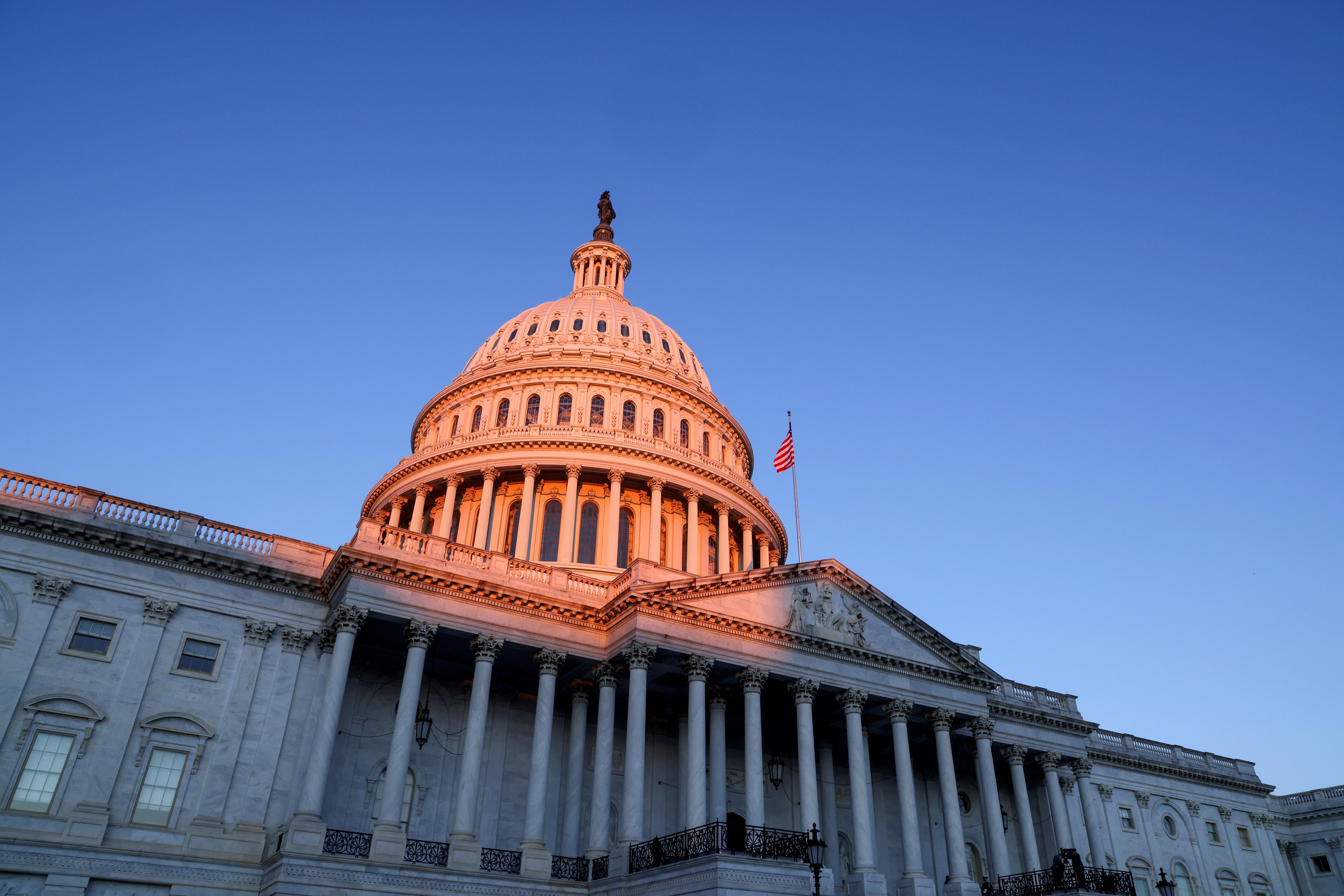 The sun rises on the U.S. Capitol dome before Joe Biden's presidential inauguration in Washington, U.S., January 20, 2021. REUTERS/Jonathan Ernst/File Photo