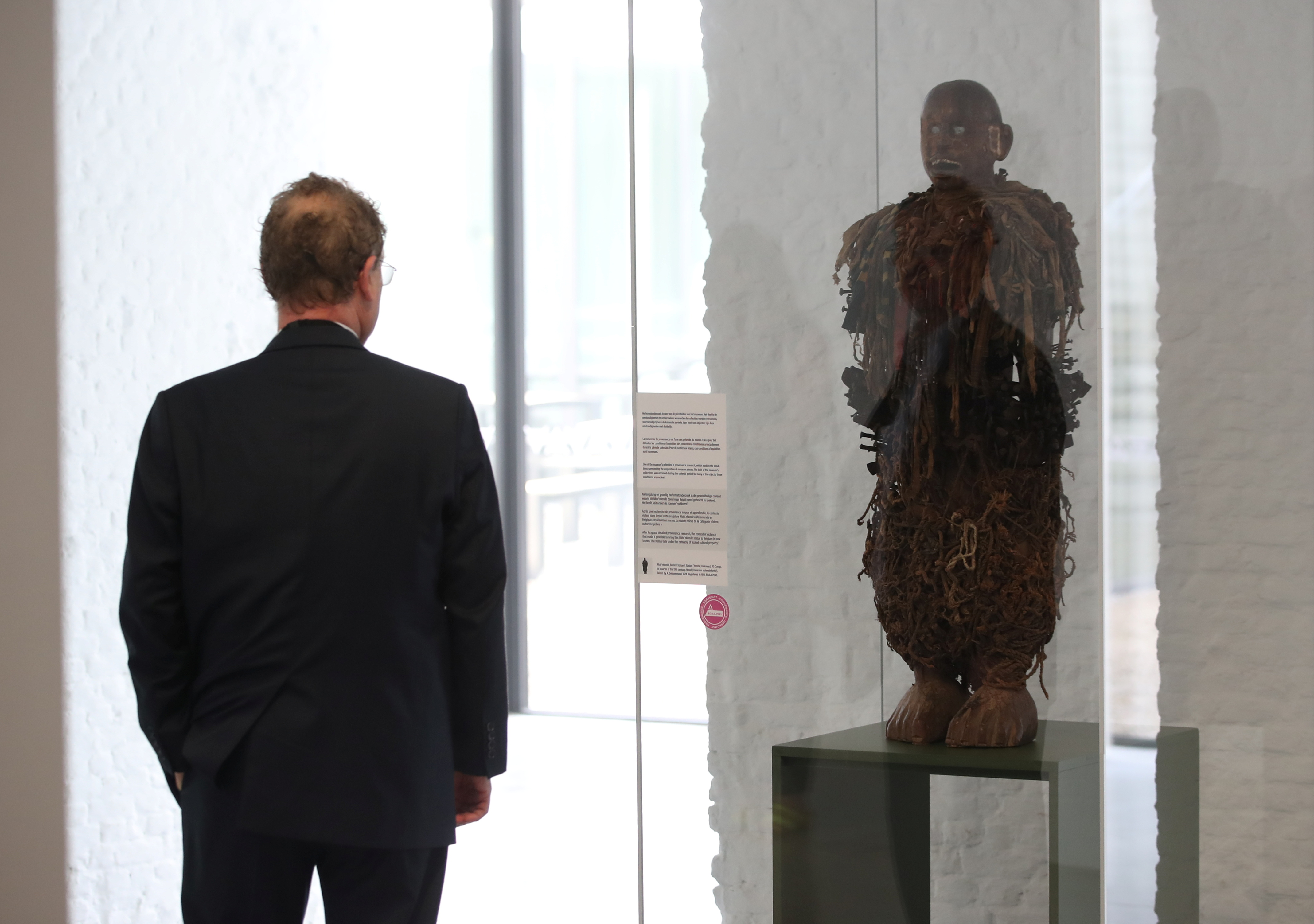 Director General of the Royal Museum for Central Africa (RMCA), Guido Gryseels, looks at a statue, dated to the 19th century, as Belgian government has announced plans to return pieces of art looted from Congo during colonial rule, in Tervuren, Belgium July 6, 2021.  REUTERS/Yves Herman