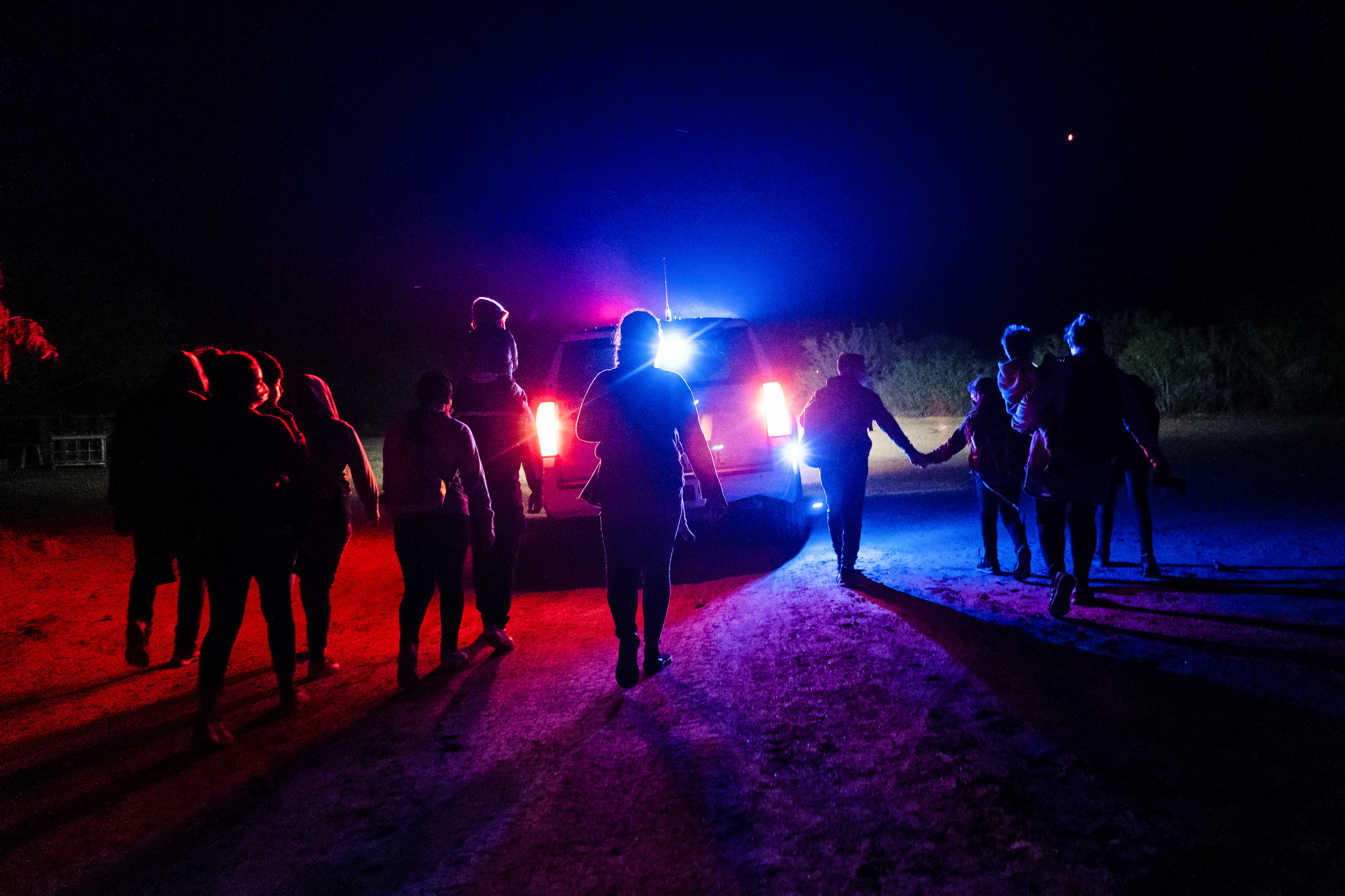 Asylum-seeking migrant families walk while being escorted by the U.S. Border Patrol after crossing the Rio Grande river into the United States from Mexico, in Roma, Texas, U.S. May 6, 2021. REUTERS/Go Nakamura