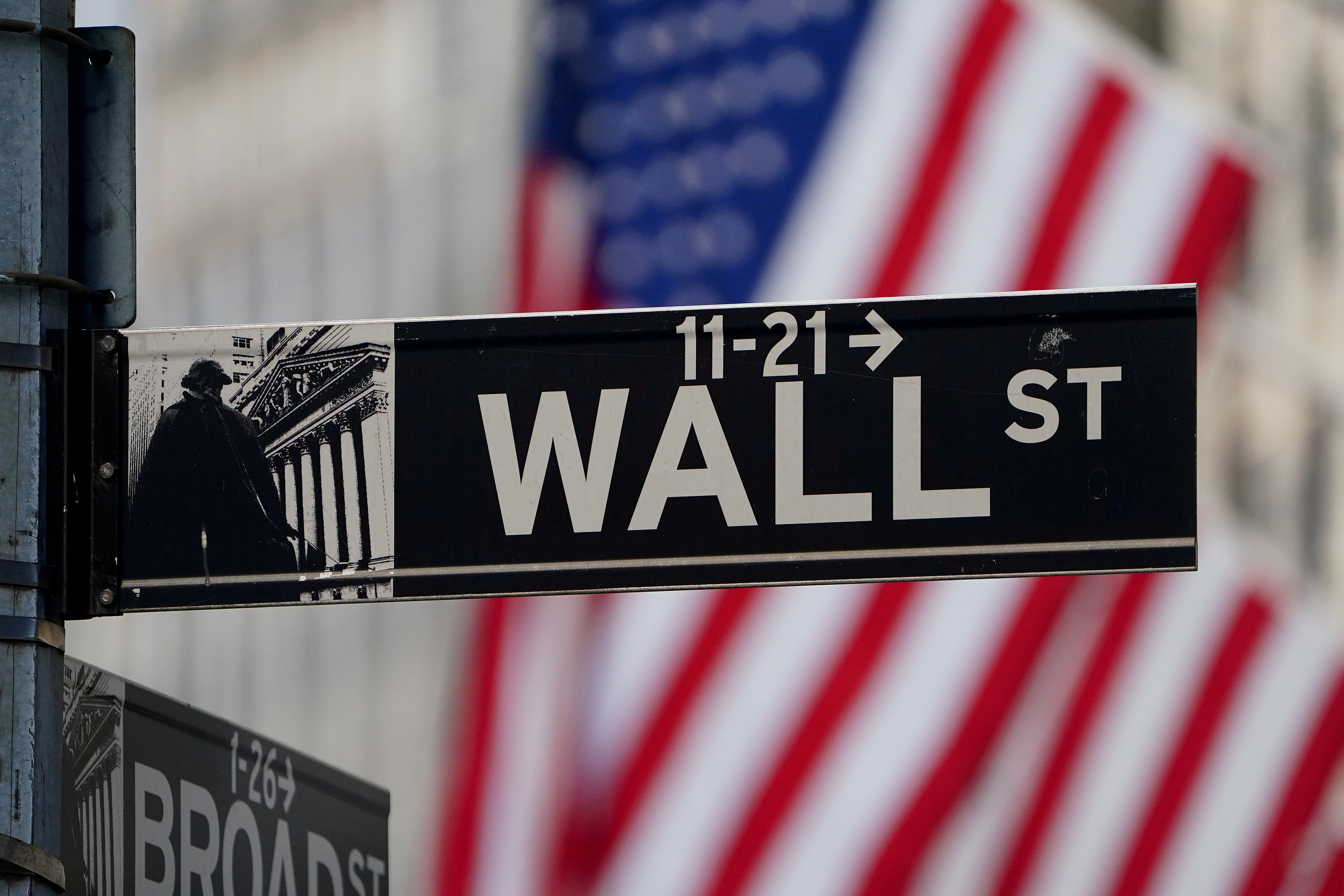 The Wall Street sign is pictured at the New York Stock exchange (NYSE) in the Manhattan borough of New York City, New York, U.S., March 9, 2020. REUTERS/Carlo Allegri/File Photo