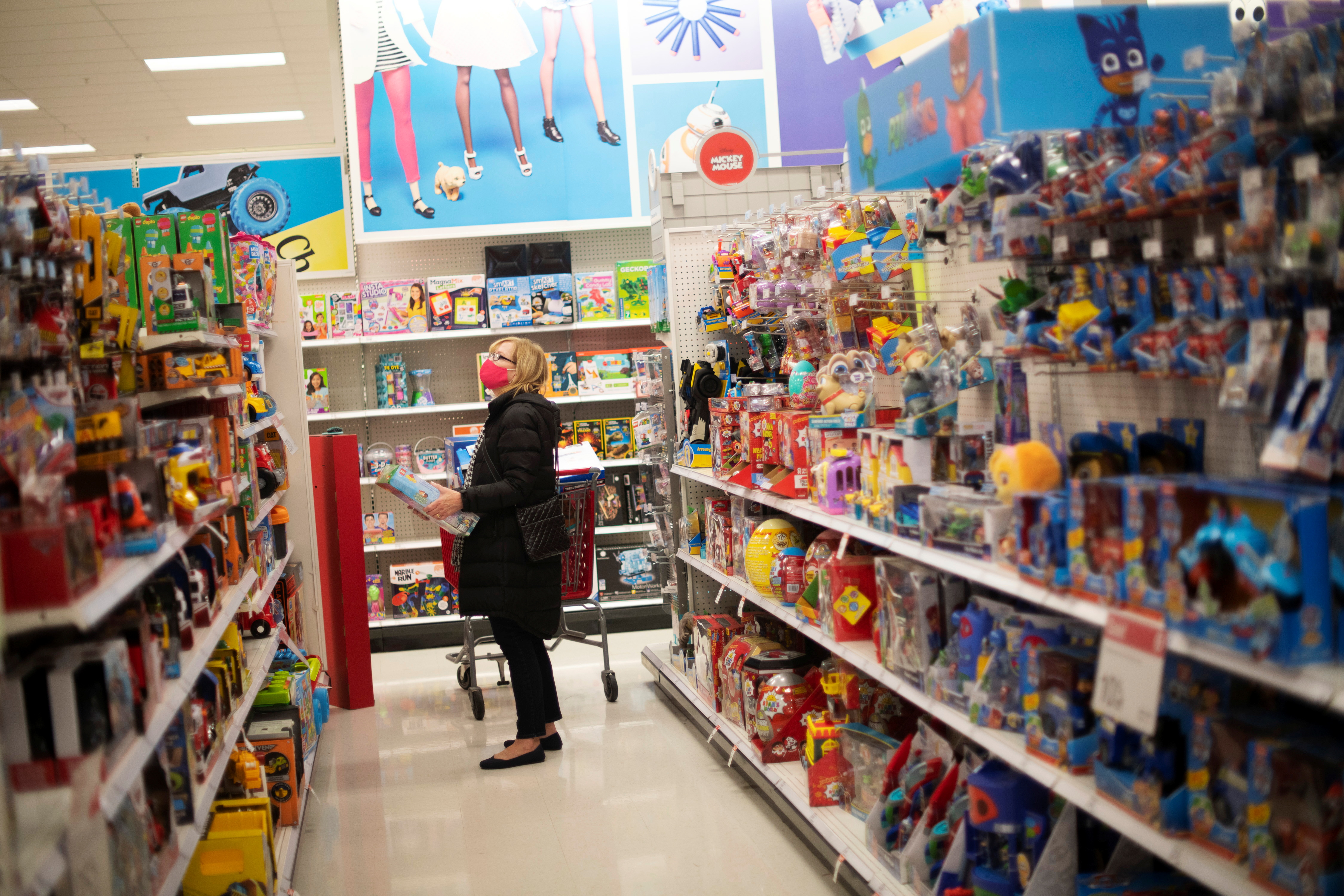 A shopper wearing a face mask due to the coronavirus disease (COVID-19) pandemic browses toys at a Target store in King of Prussia, Pennsylvania U.S. November 20, 2020. REUTERS/Mark Makela/Files