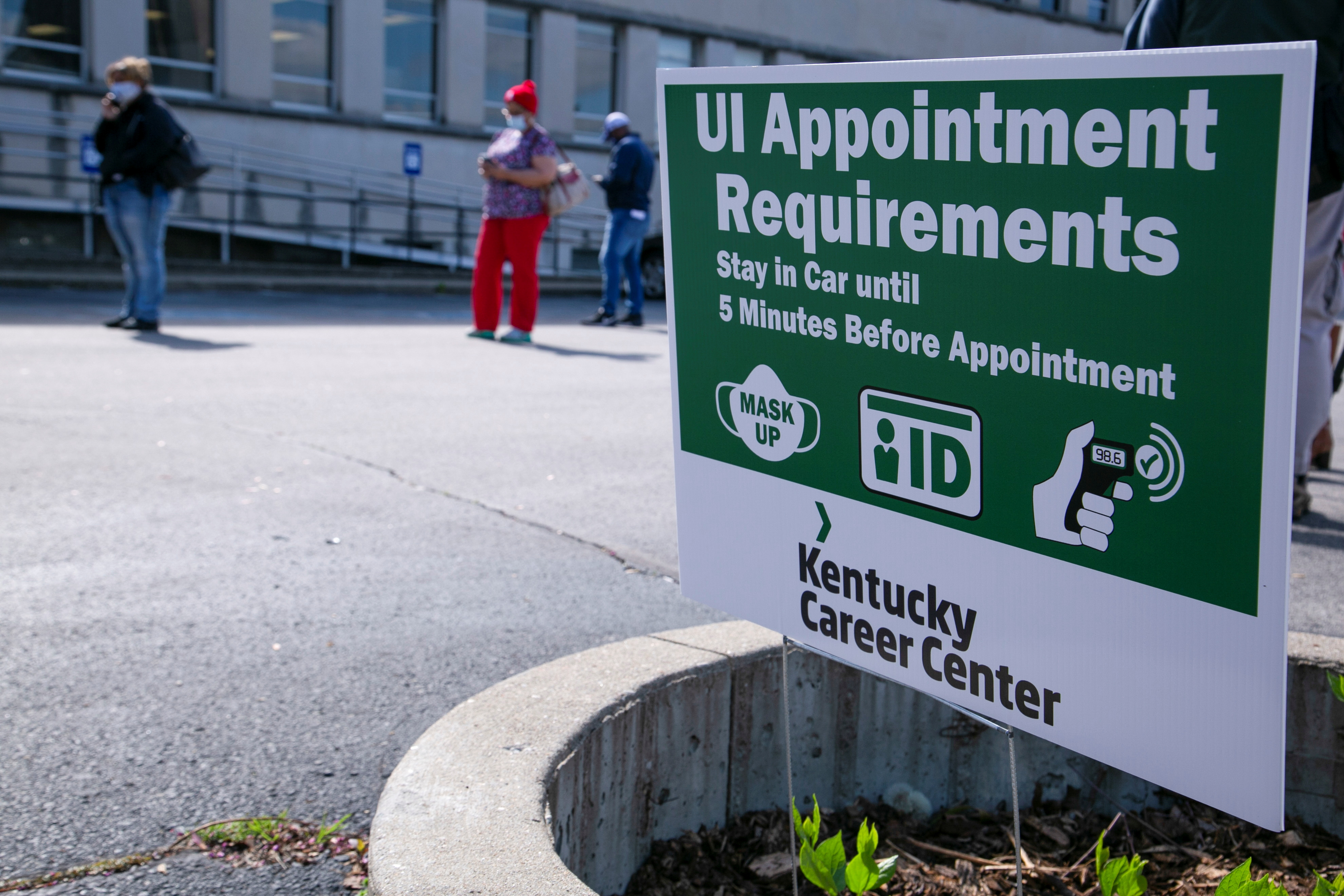 People wait in line as Kentucky Labor Cabinet reopens 13 Regional Career Centers for in-person unemployment insurance services, in Louisville, Kentucky, U.S., April 15, 2021. REUTERS/Amira Karaoud