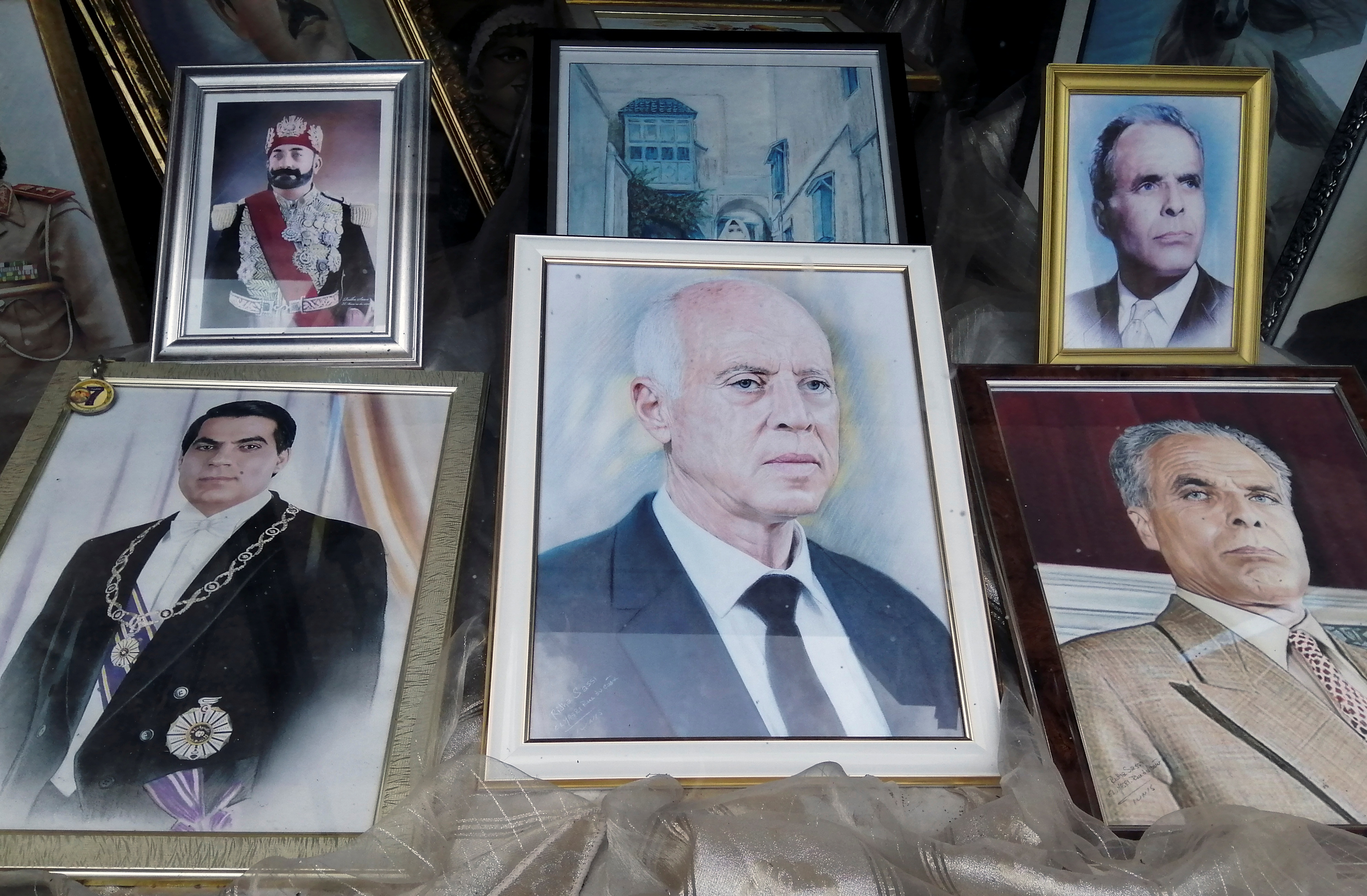 A portrait of Tunisian President Kais Saied and late President Zine El Abidine Ben Ali are displayed inside a photography shop in Tunis, Tunisia September 23, 2021. REUTERS/Jihed Abidellaoui