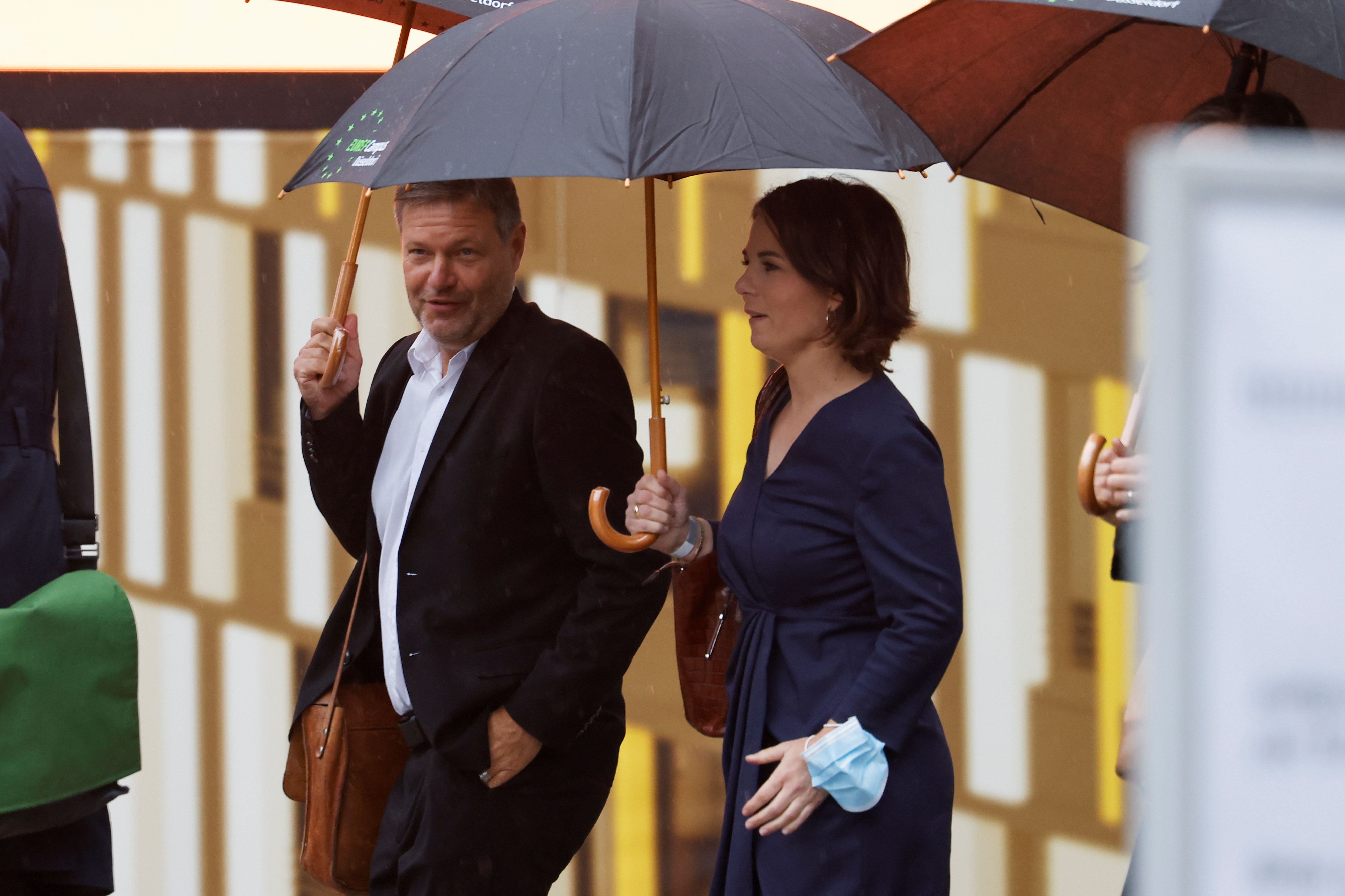 The Greens party co-leaders Annalena Baerbock and Robert Habeck arrive to attend exploratory talks between the CDU, the CSU and the Greens for a possible new government coalition in Berlin, Germany, October 5, 2021. REUTERS/Michele Tantussi