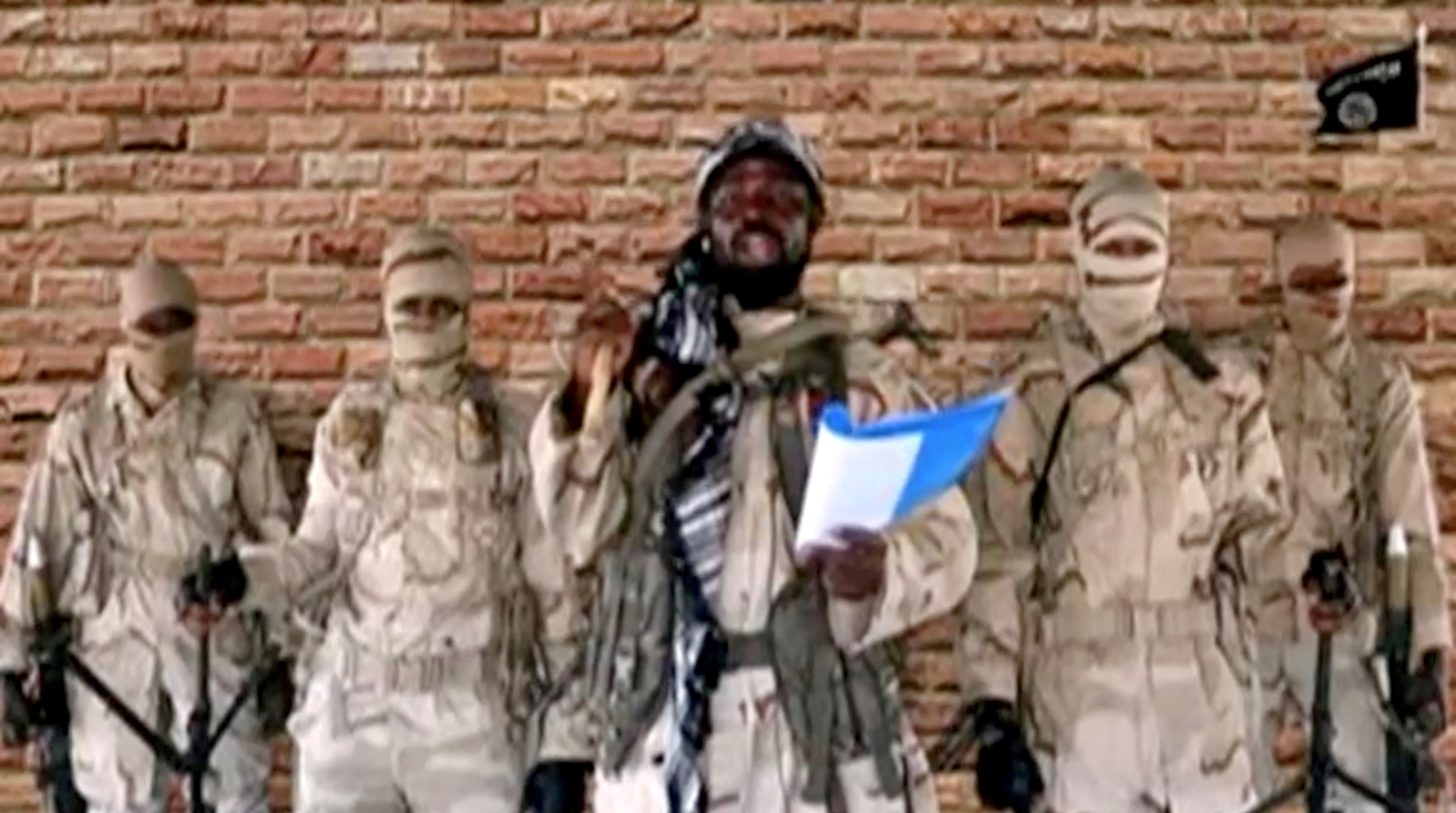 Boko Haram leader Abubakar Shekau speaks in front of guards in an unknown location in Nigeria in this still image taken from an undated video obtained on January 15, 2018. Boko Haram Handout/Sahara Reporters via REUTERS