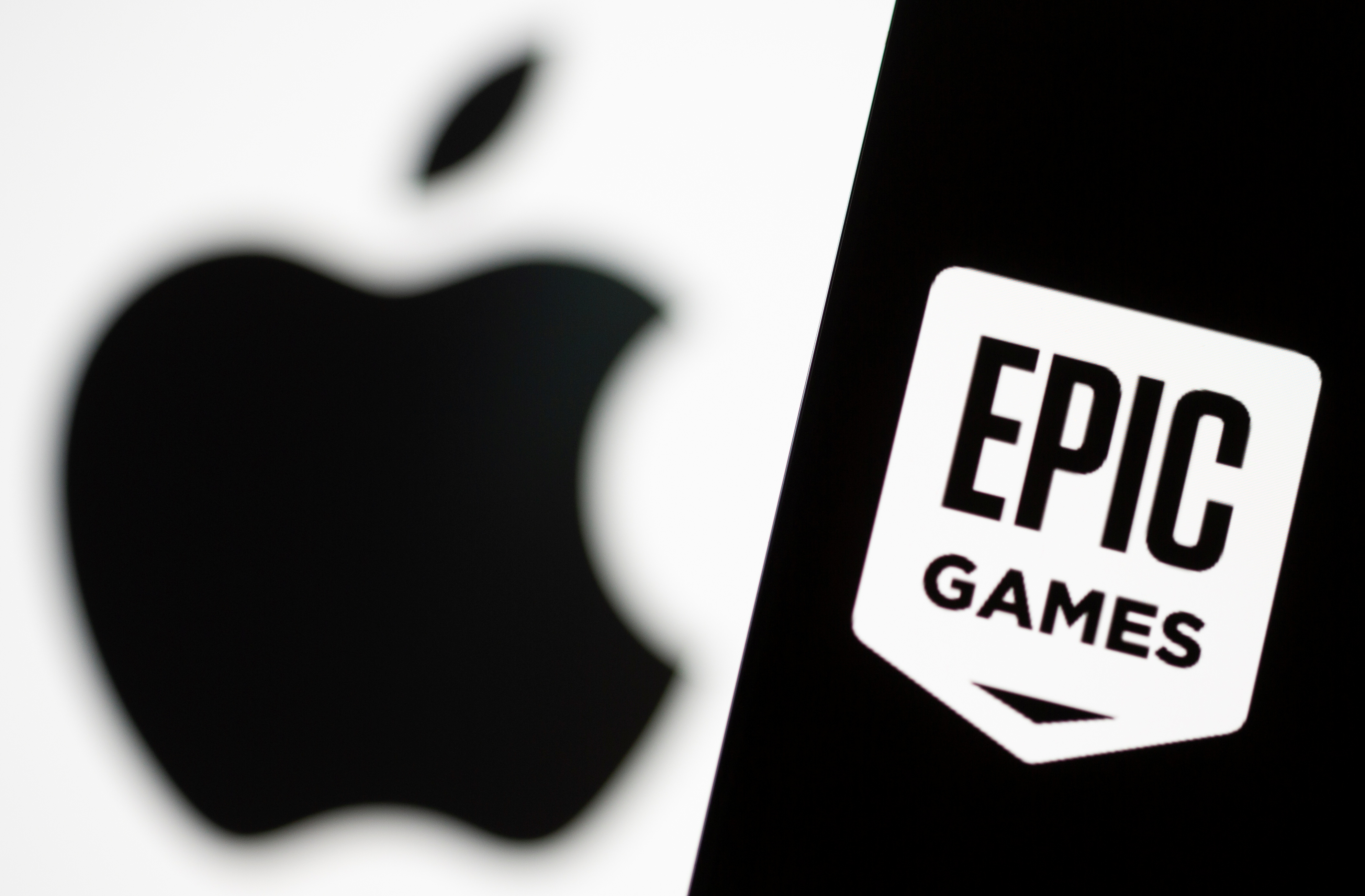 Smartphone with Epic Games logo is seen in front of Apple logo in this illustration taken, May 2, 2021. REUTERS/Dado Ruvic/Illustration
