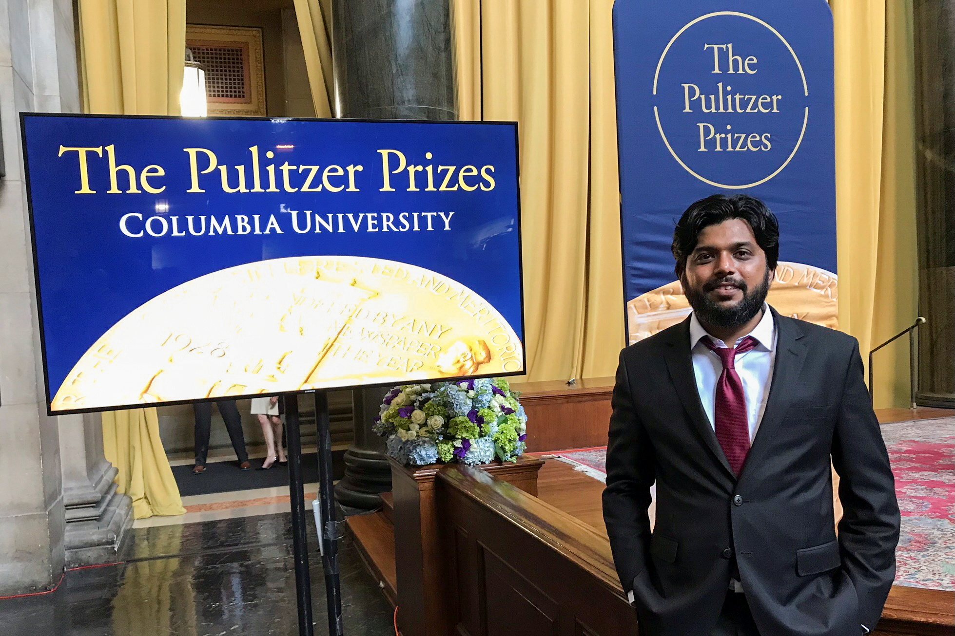 Danish Siddiqui, a Reuters photographer based in India, poses for a picture at Columbia University's Low Memorial Library during the Pulitzer Prize giving ceremony, in New York, U.S., May 30, 2018.  REUTERS/Mohammad Ponir Hossain