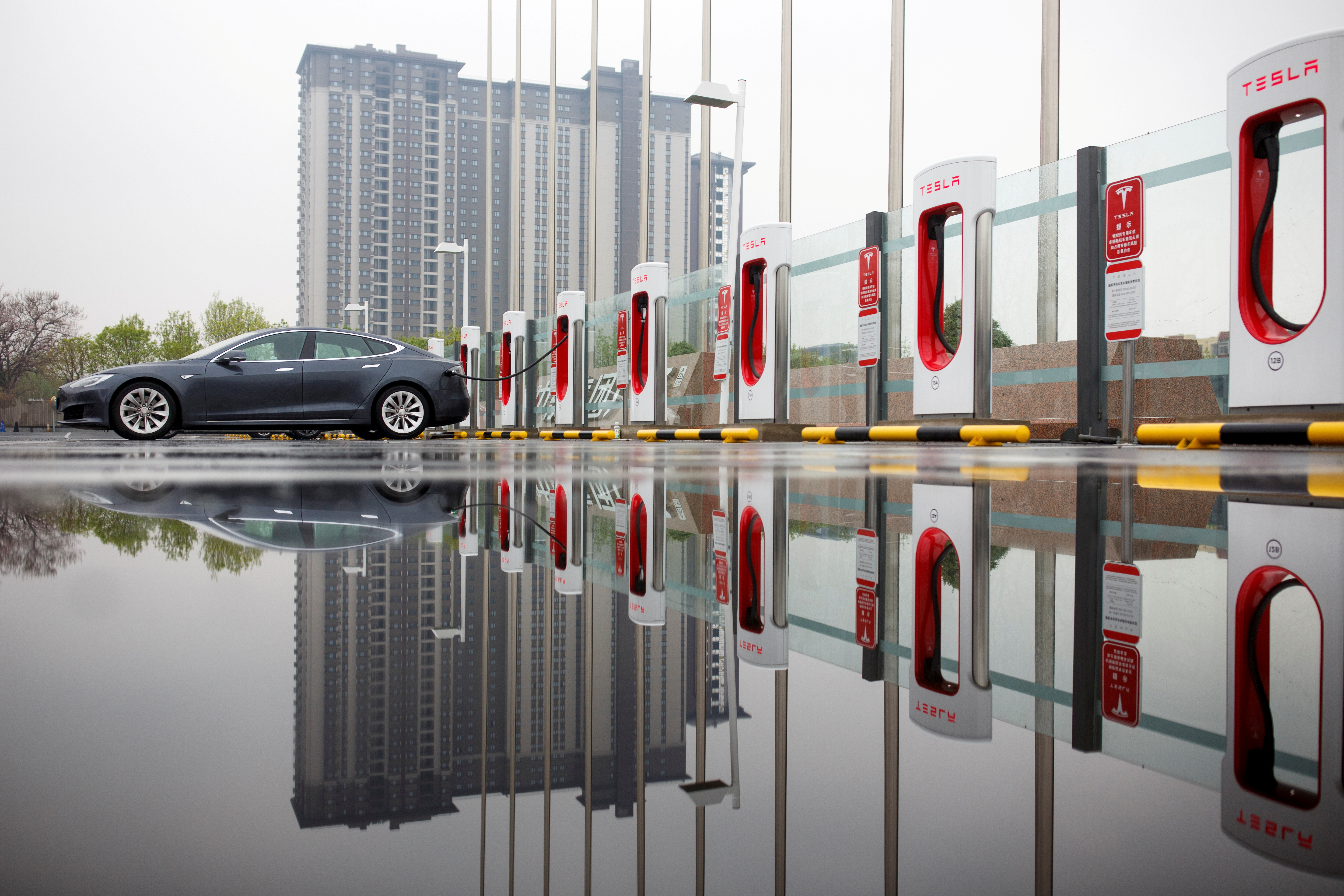 A Tesla car pictured at a charging point in Beijing, China, April 13, 2018. REUTERS/Thomas Peter/File Photo