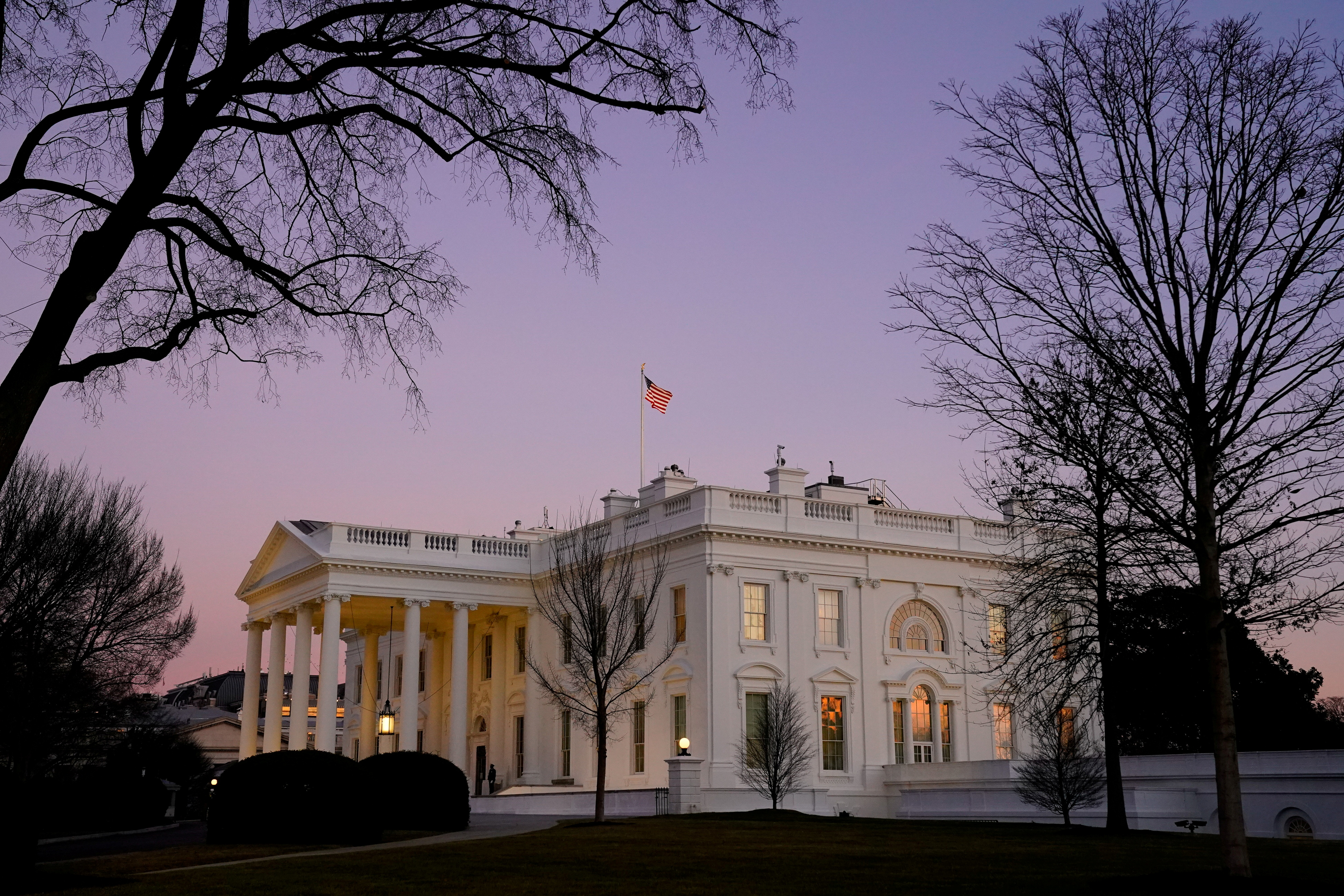 The White House is seen at sunset on U.S. President Joe Biden's first day in office in Washington, U.S., January 20, 2021. REUTERS/Erin Scott/File Photo