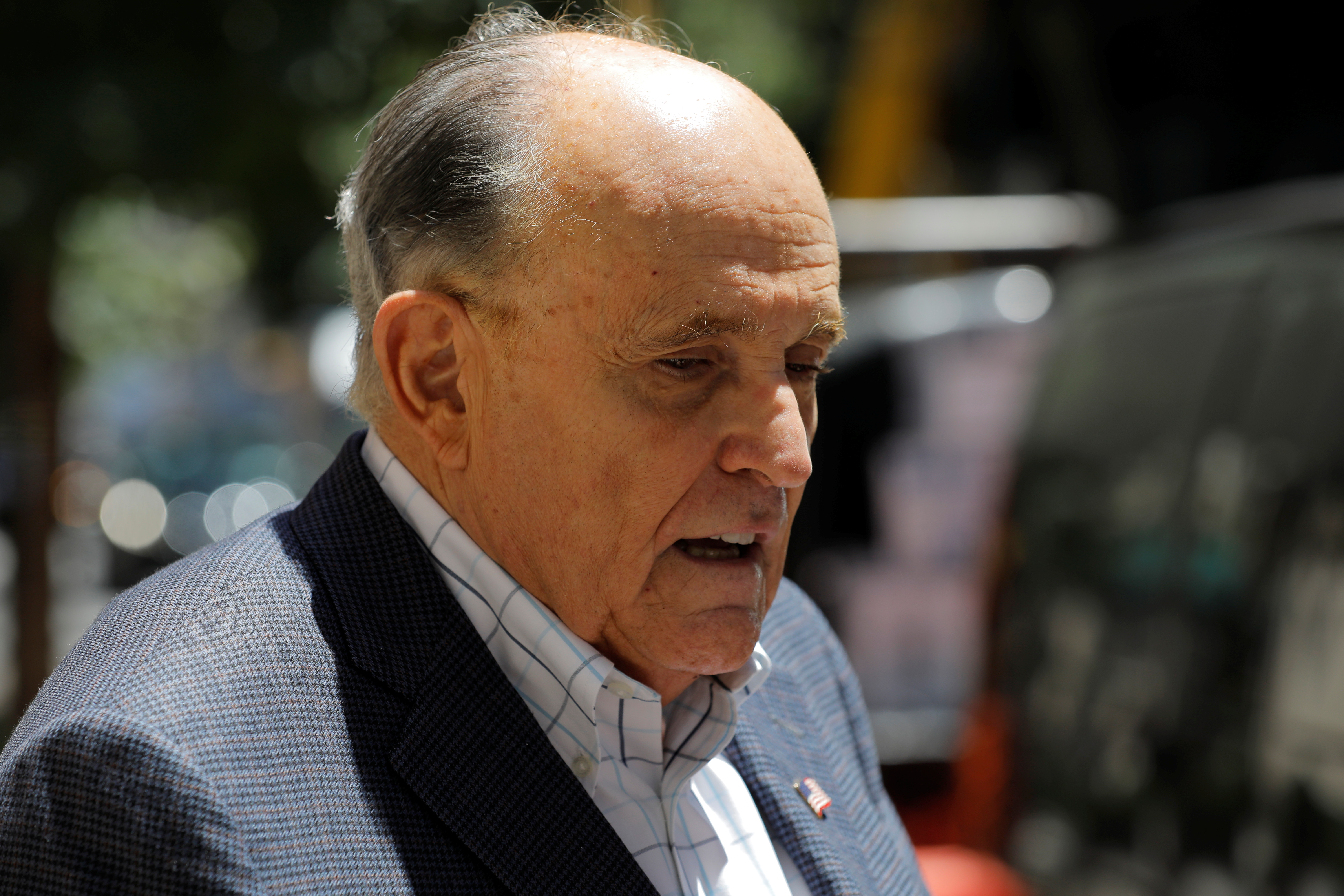 Former New York City Mayor Rudy Giuliani speaks to media outside his apartment building after suspension of his law license in Manhattan in New York City, New York, U.S., June 24, 2021. REUTERS/Andrew Kelly