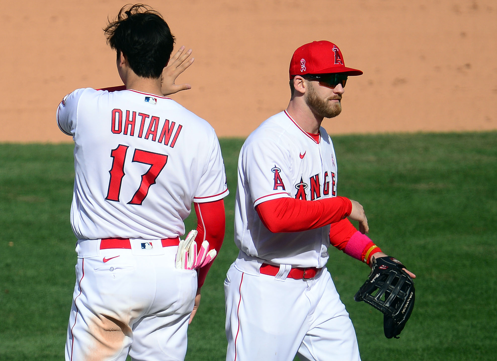 May 9, 2021; Anaheim, California, USA; Los Angeles Angels first baseman Jared Walsh (20) and designated hitter Shohei Ohtani (17) celebrate the 2-1 victory against the Los Angeles Dodgers at Angel Stadium. Mandatory Credit: Gary A. Vasquez-USA TODAY Sports