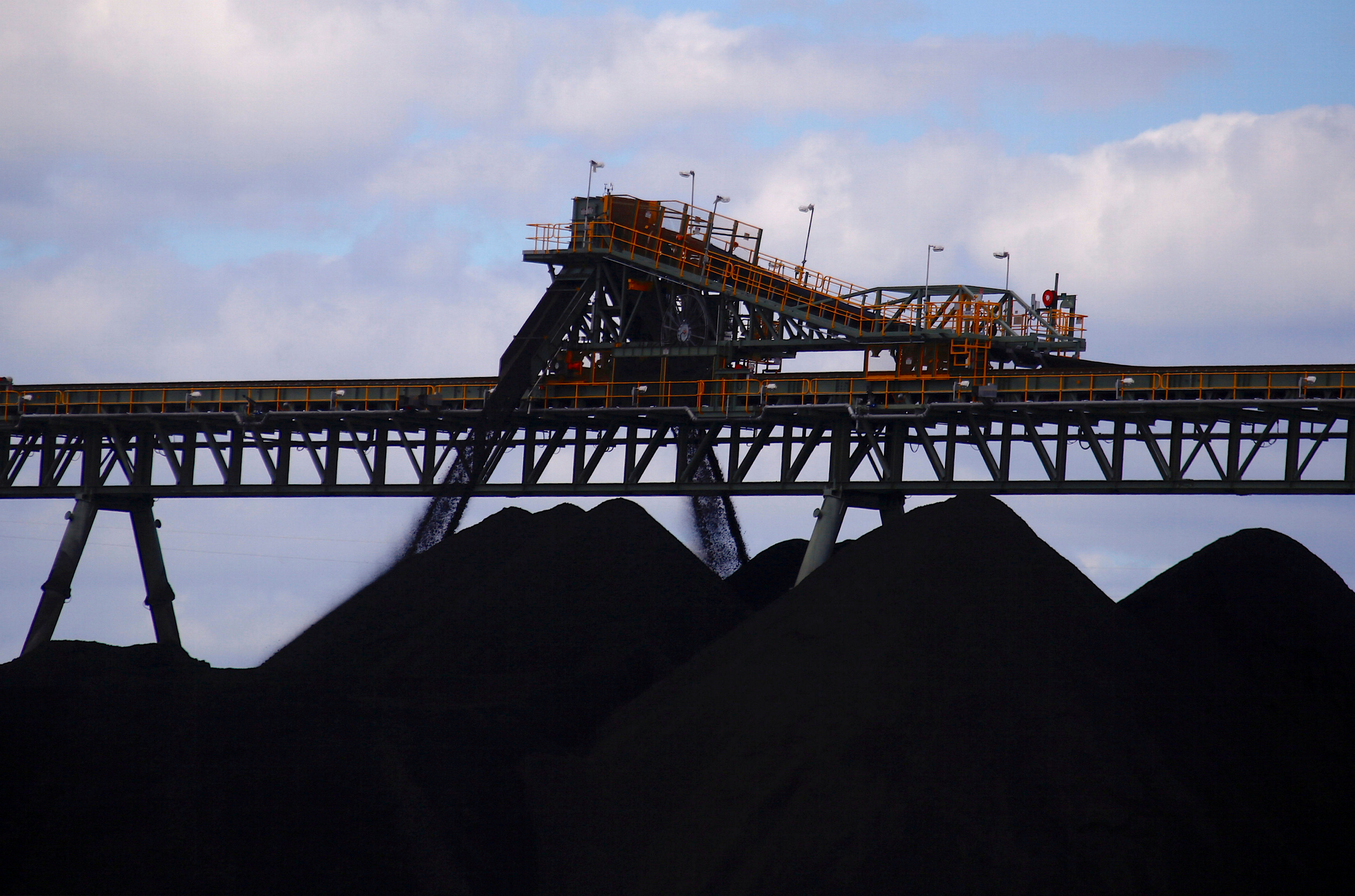Coal is unloaded onto large piles at the Ulan Coal mines near the central New South Wales rural town of Mudgee in Australia, March 8, 2018. REUTERS/David Gray/File Photo