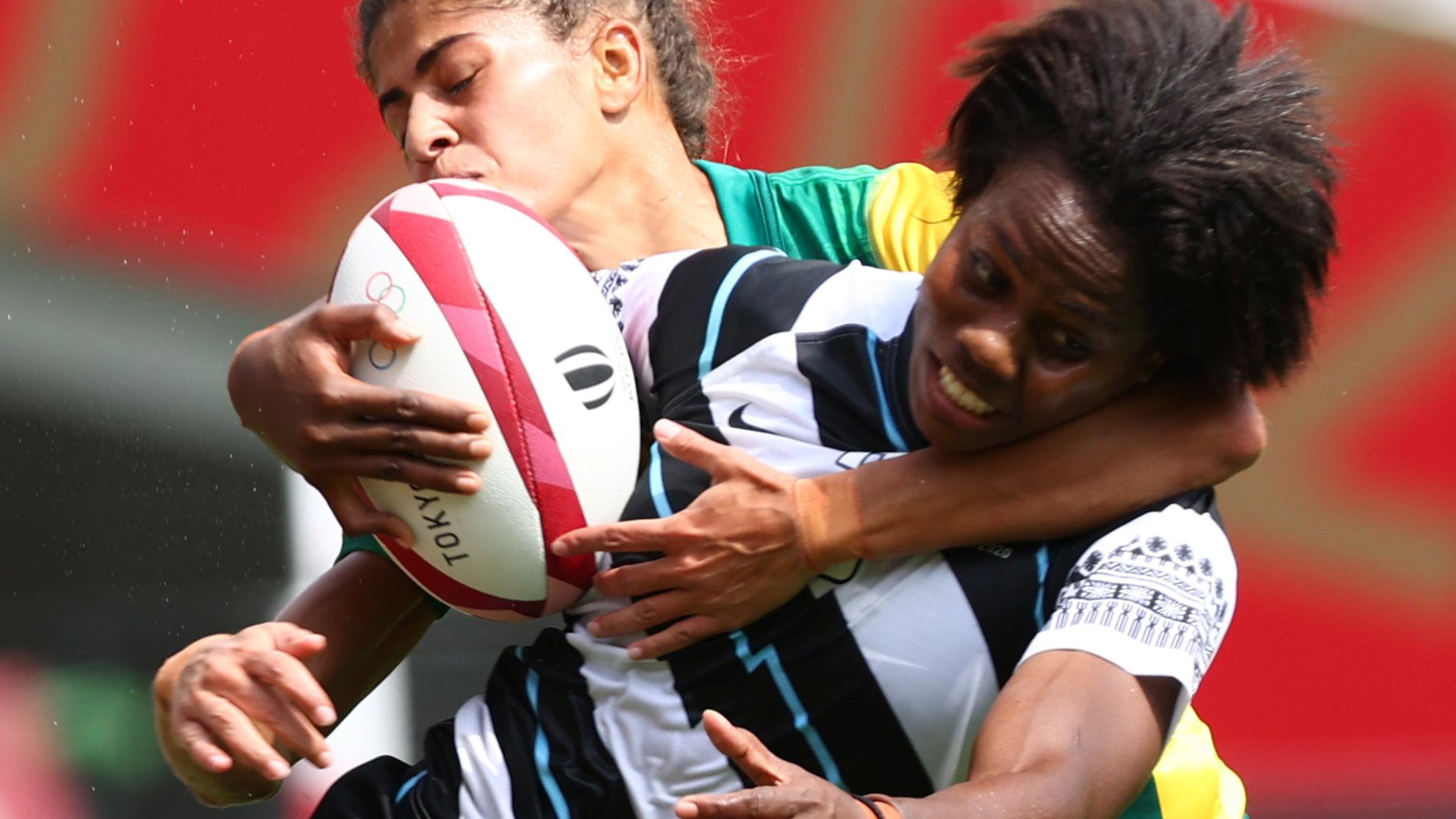 Tokyo 2020 Olympics - Rugby Sevens - Women - Pool B - Fiji v Brazil - Tokyo Stadium - Tokyo, Japan - July 30, 2021. Raijieli Daveua of Fiji in action with Bianca Silva of Brazil. REUTERS/Edgard Garrido - SP1EH7U01BH6A