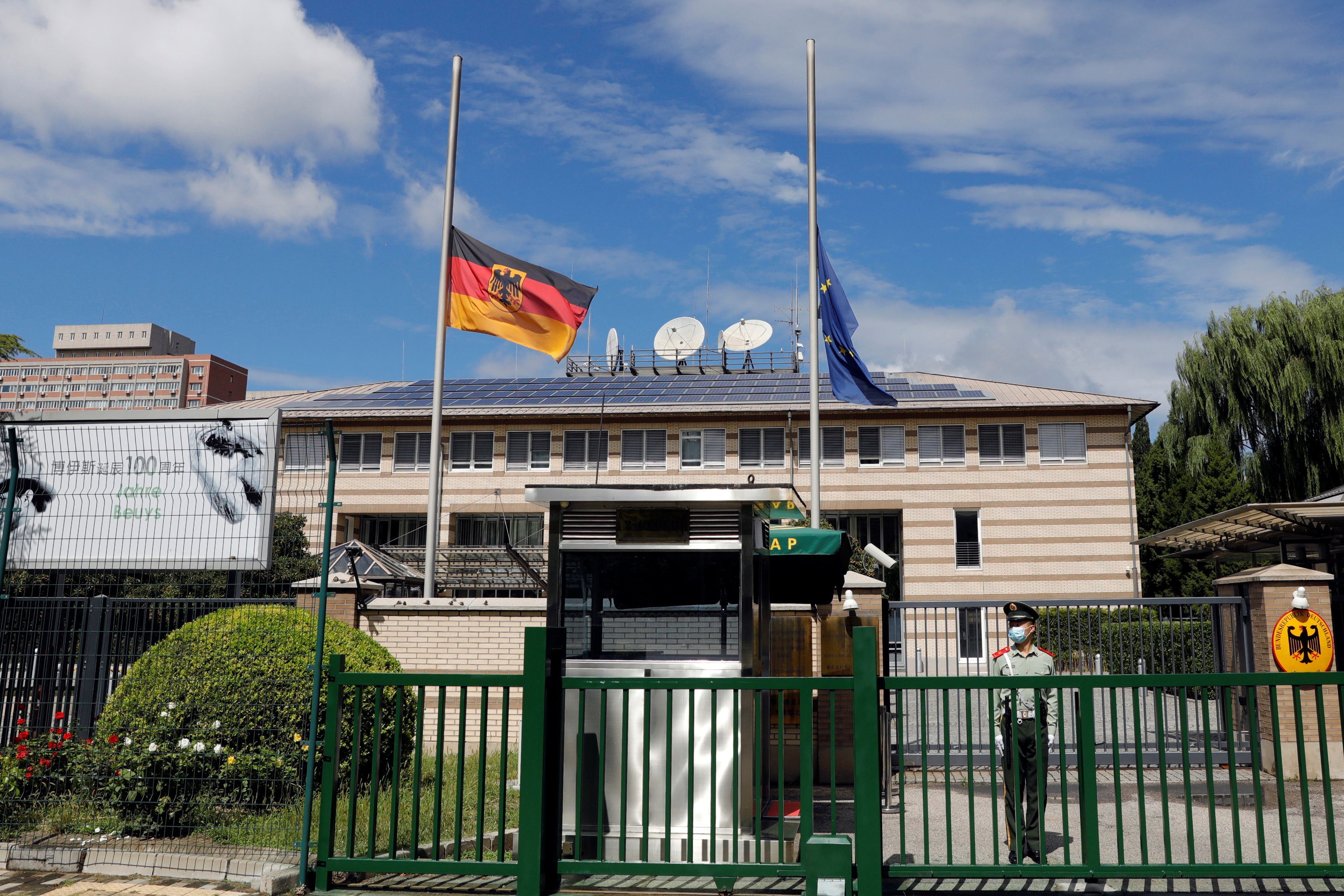 The German and European Union flags fly at half mast after German ambassador to China Jan Hecker passed away, at the Germany embassy in Beijing, China September 6, 2021. REUTERS/Carlos Garcia Rawlins