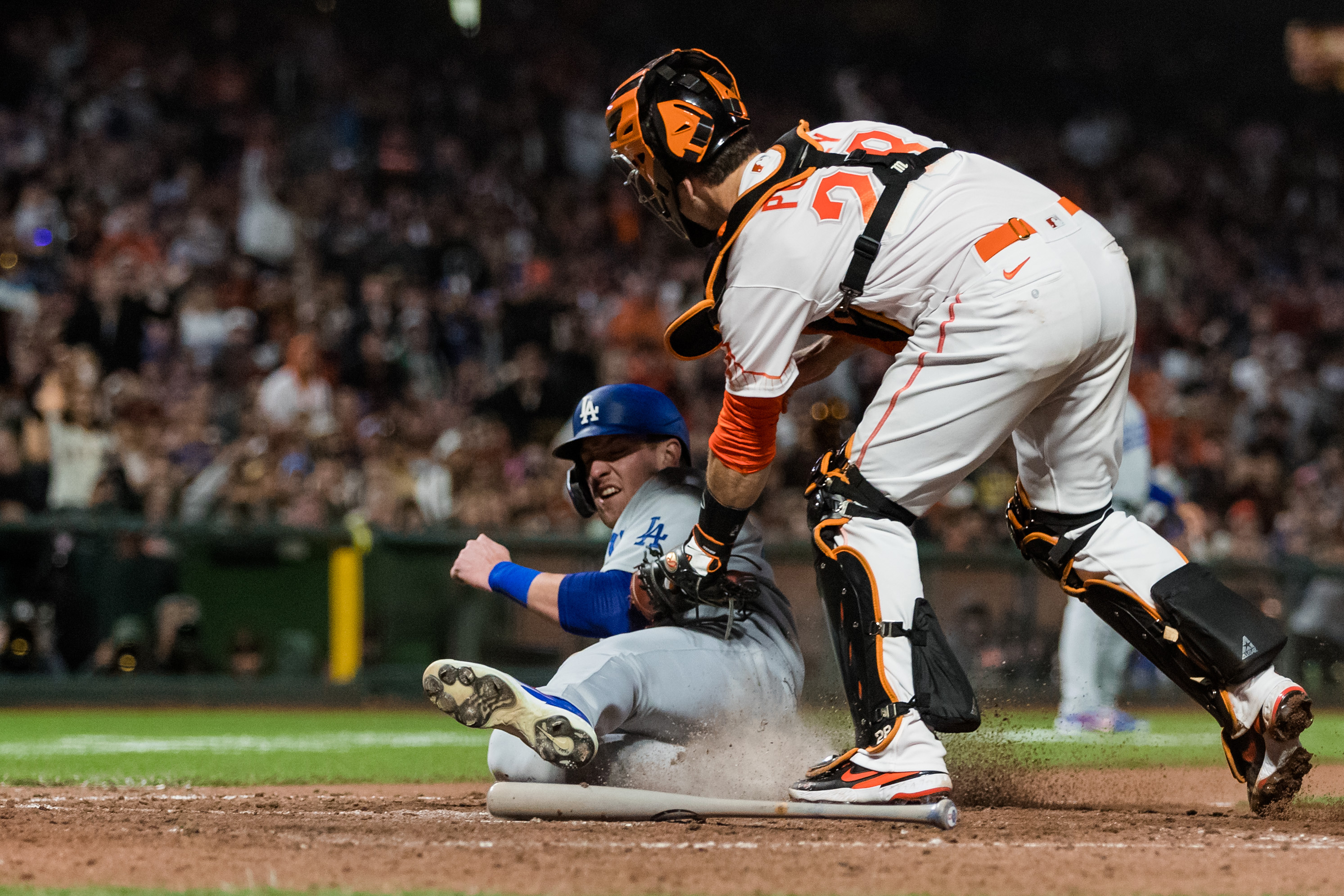 Jul 27, 2021; San Francisco, California, USA; San Francisco Giants catcher Buster Posey (28) tags Los Angeles Dodgers left fielder Luke Raley (37) in the eighth inning at Oracle Park. Mandatory Credit: John Hefti-USA TODAY Sports