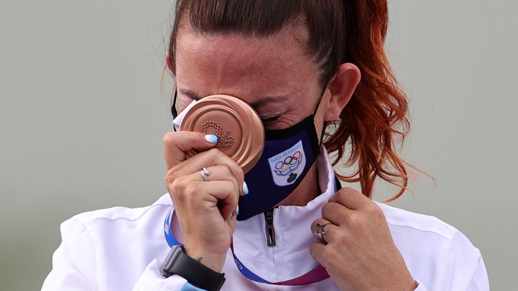 Tokyo 2020 Olympics - Shooting - Women's Trap - Medal Ceremony - Asaka Shooting Range, Tokyo, Japan - July 29, 2021. Bronze medalist Alessandra Perilli of San Marino reacts REUTERS/Ann Wang