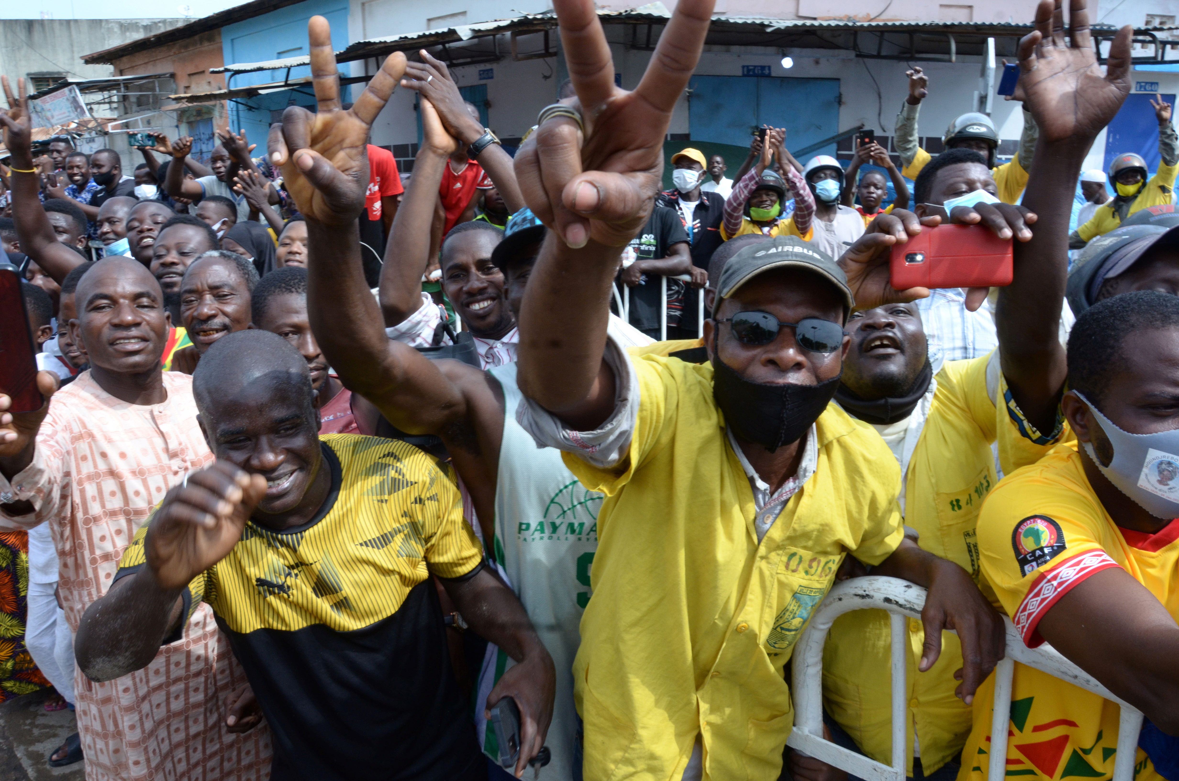 Supporters of Benin's President Patrice Talon gather to cheer him outside a polling station in Cotonou, Benin April 11, 2021. REUTERS/Charle Placide Tossou