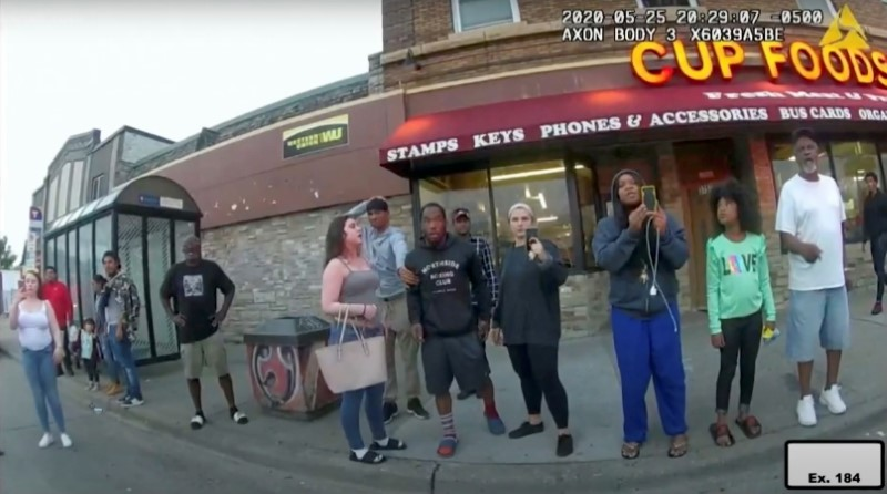 Darnella Frazier (3rd R) uses her mobile phone to record the arrest of George Floyd, in a still image taken from Minneapolis Police body camera video in Minneapolis, Minnesota, U.S. May 25, 2020.  Minneapolis Police Department/Handout via REUTERS