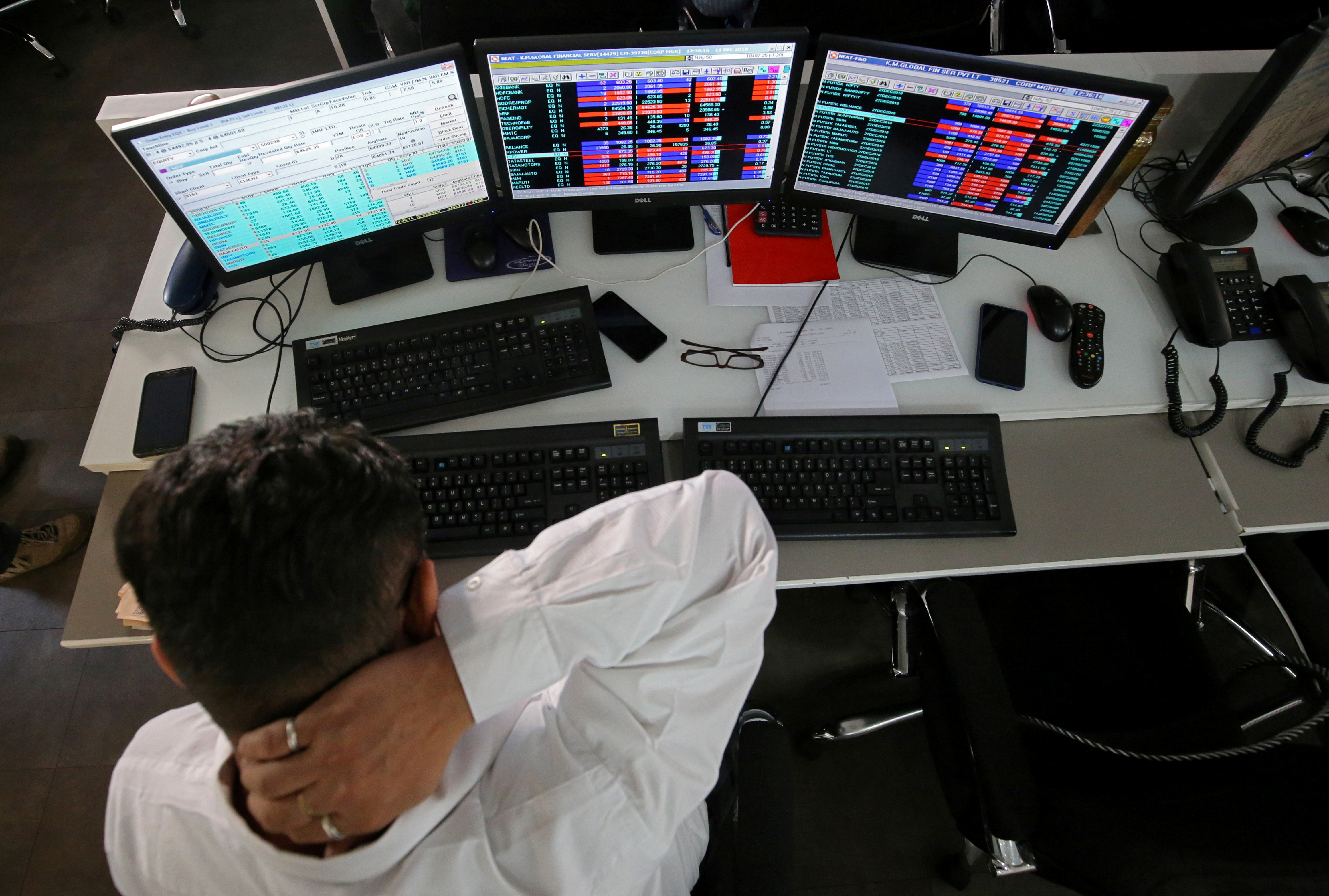 A broker reacts while trading at his computer terminal at a stock brokerage firm in Mumbai, India, December 11, 2018. REUTERS/Francis Mascarenhas/File Photo