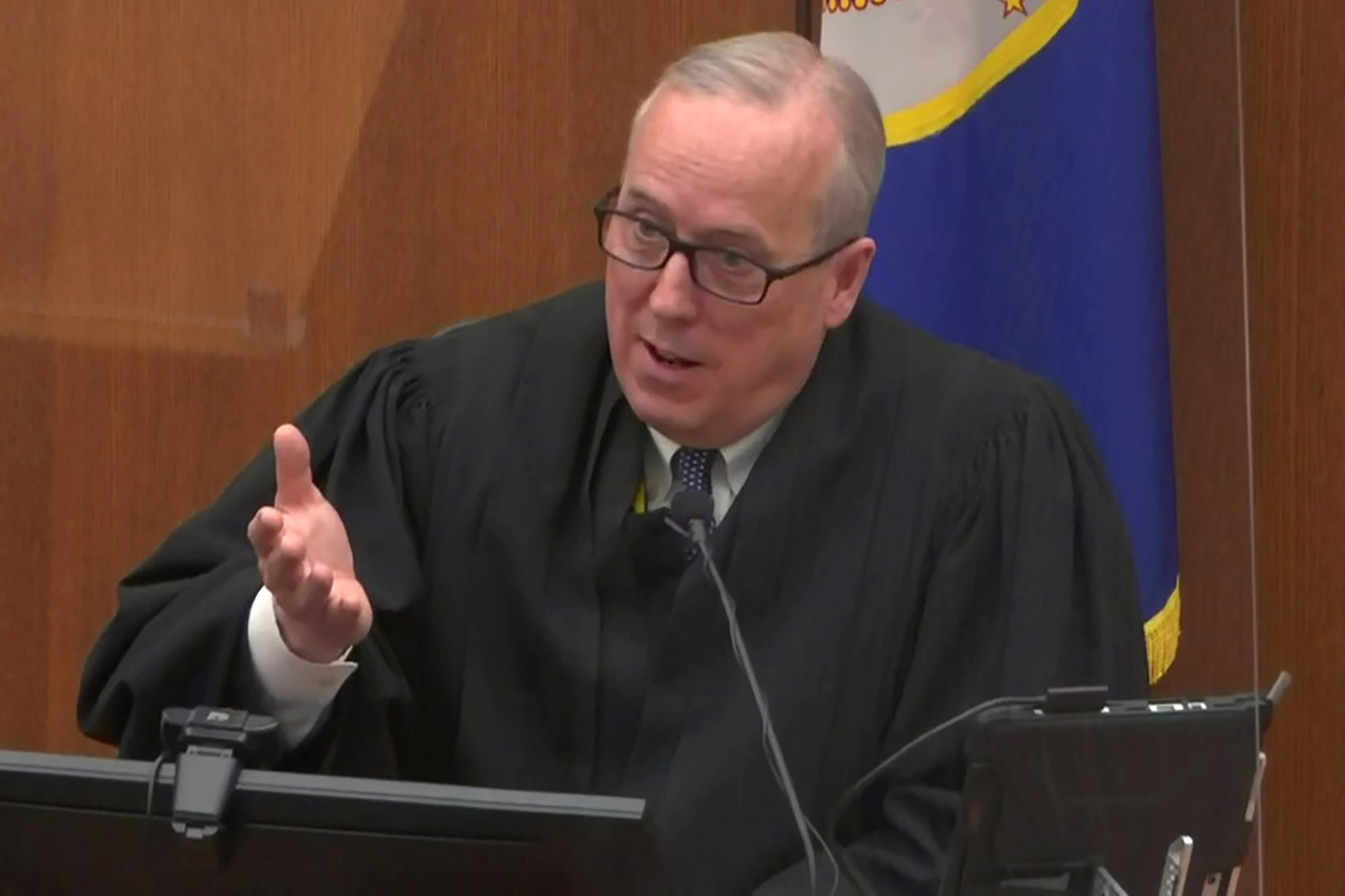 Hennepin County District Judge Peter Cahill speaks with legal teams on the eleventh day of the trial of former Minneapolis police officer Derek Chauvin for second-degree murder, third-degree murder and second-degree manslaughter in the death of George Floyd in Minneapolis, Minnesota, U.S. April 12, 2021 in a still image from video.  Pool via REUTERS