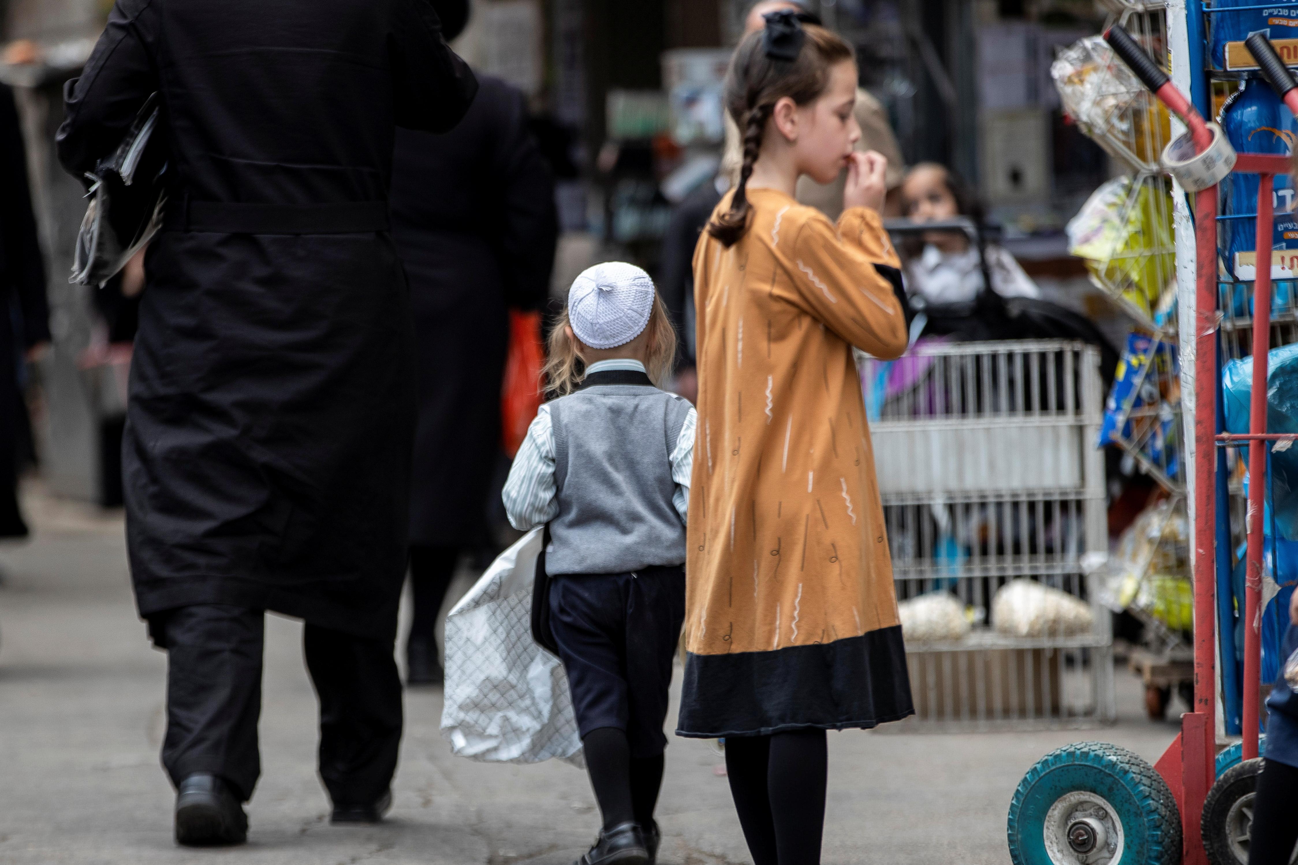 Ultra Orthodox Jews walk in a street in Jerusalem July 25, 2021.    REUTERS/ Ronen Zvulun