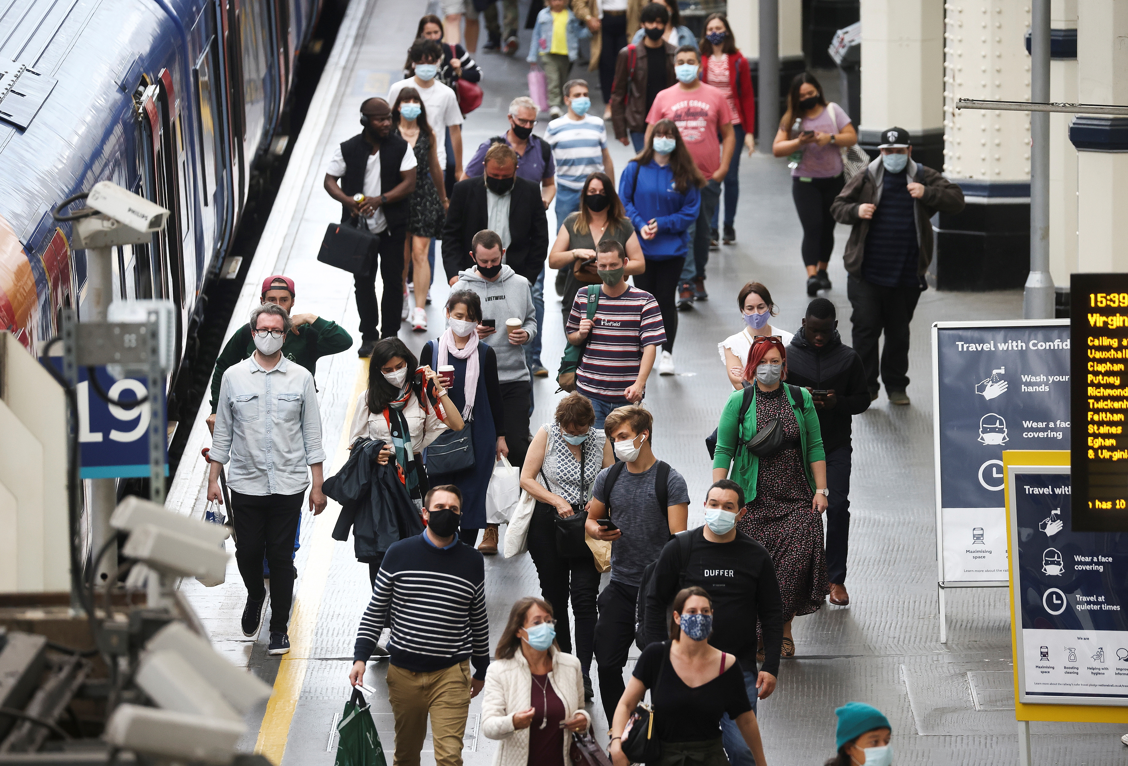 People, some wearing protective face masks, walk through Waterloo Station, amid the coronavirus disease (COVID-19) pandemic, in London, Britain, July 4, 2021. REUTERS/Henry Nicholls