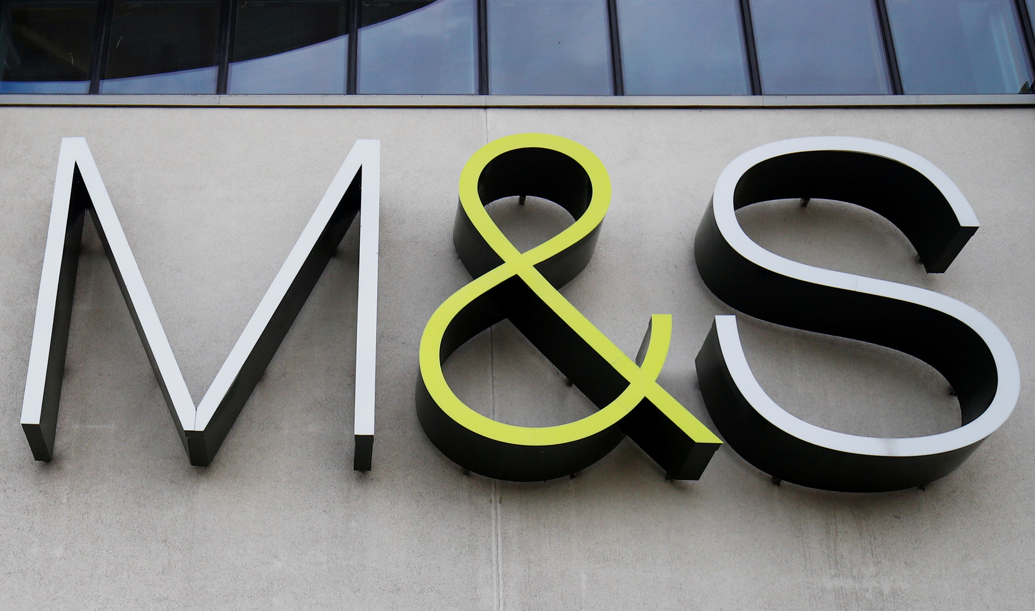 A Marks and Spencer (M&S) logo outside of a store in Cheshire, Britain  August 18, 2020. REUTERS/Jason Cairnduff
