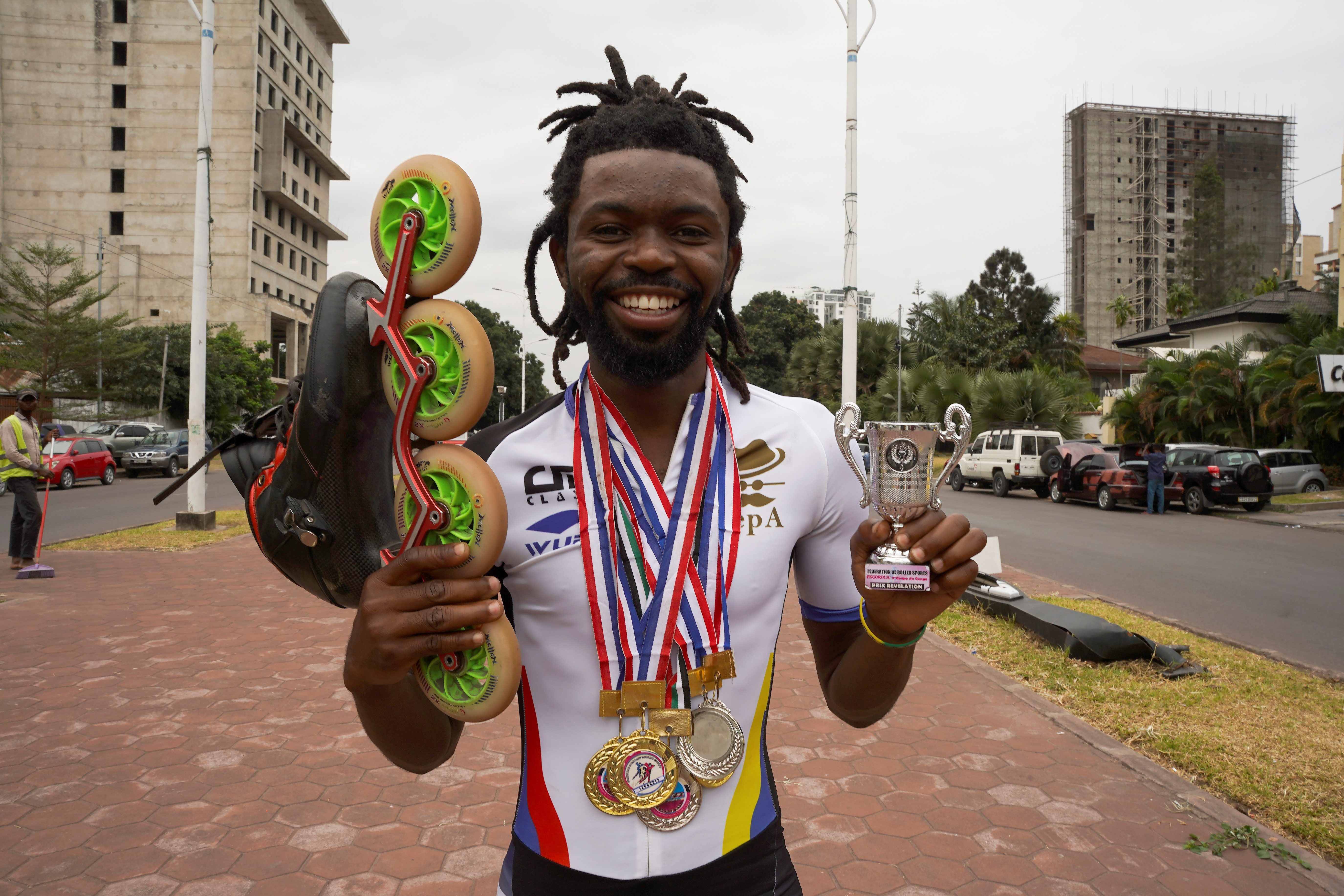 Serge Makolo holds his roller skate and a trophy he won at the speed skating competition, in Kinshasa, Democratic Republic of Congo, September 16, 2021. REUTERS/Hereward Holland