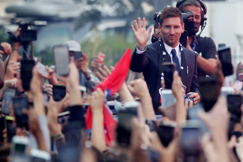 Soccer Football - Lionel Messi Press Conference after signing for Paris St Germain - Parc des Princes, Paris, France - August 11, 2021 Paris St Germain's Lionel Messi gestures to fans outside the stadium after the press conference REUTERS/Yves Herman