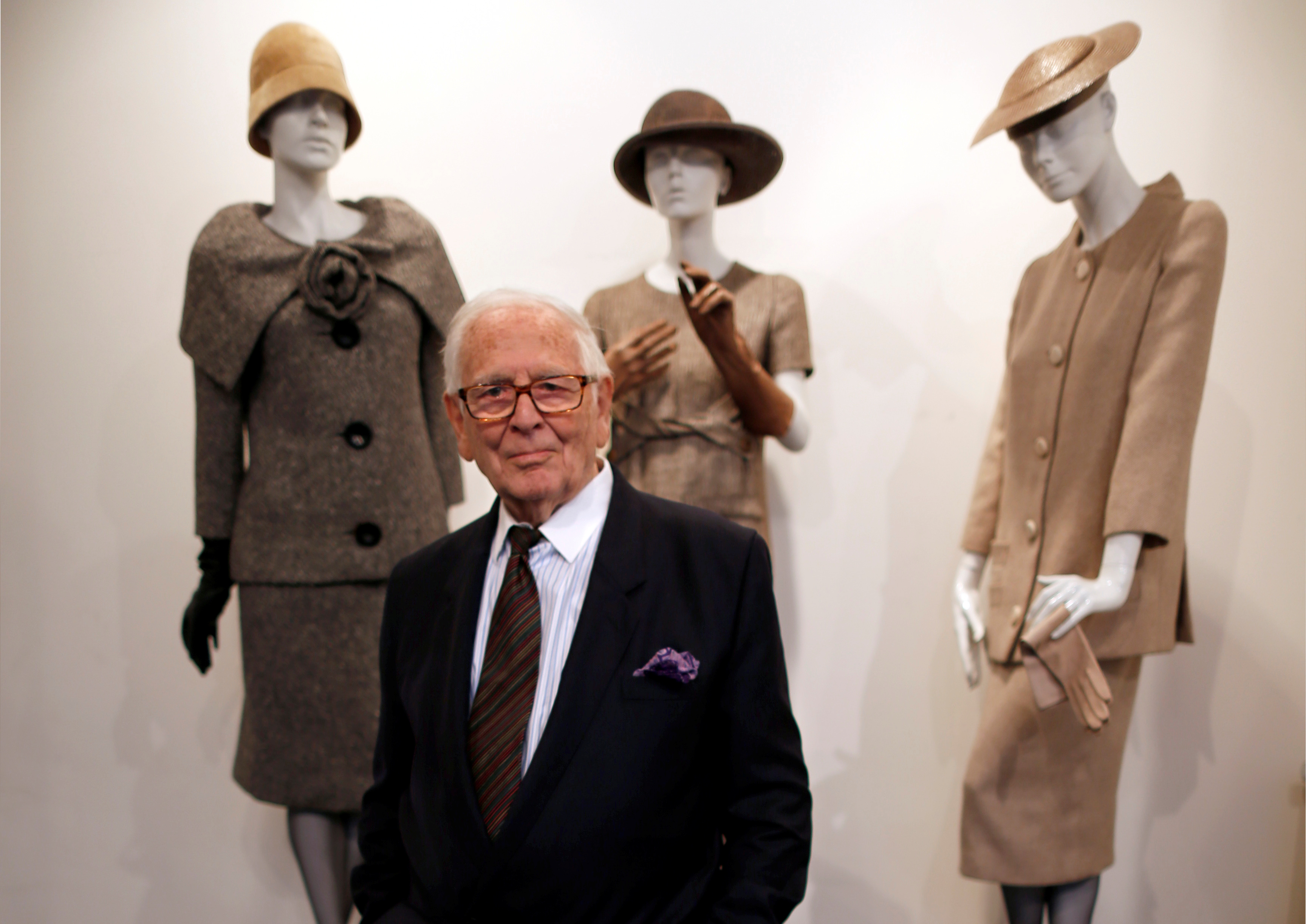 French fashion designer Pierre Cardin poses in front of his 1954-1956-1957 fashion creations in his museum called