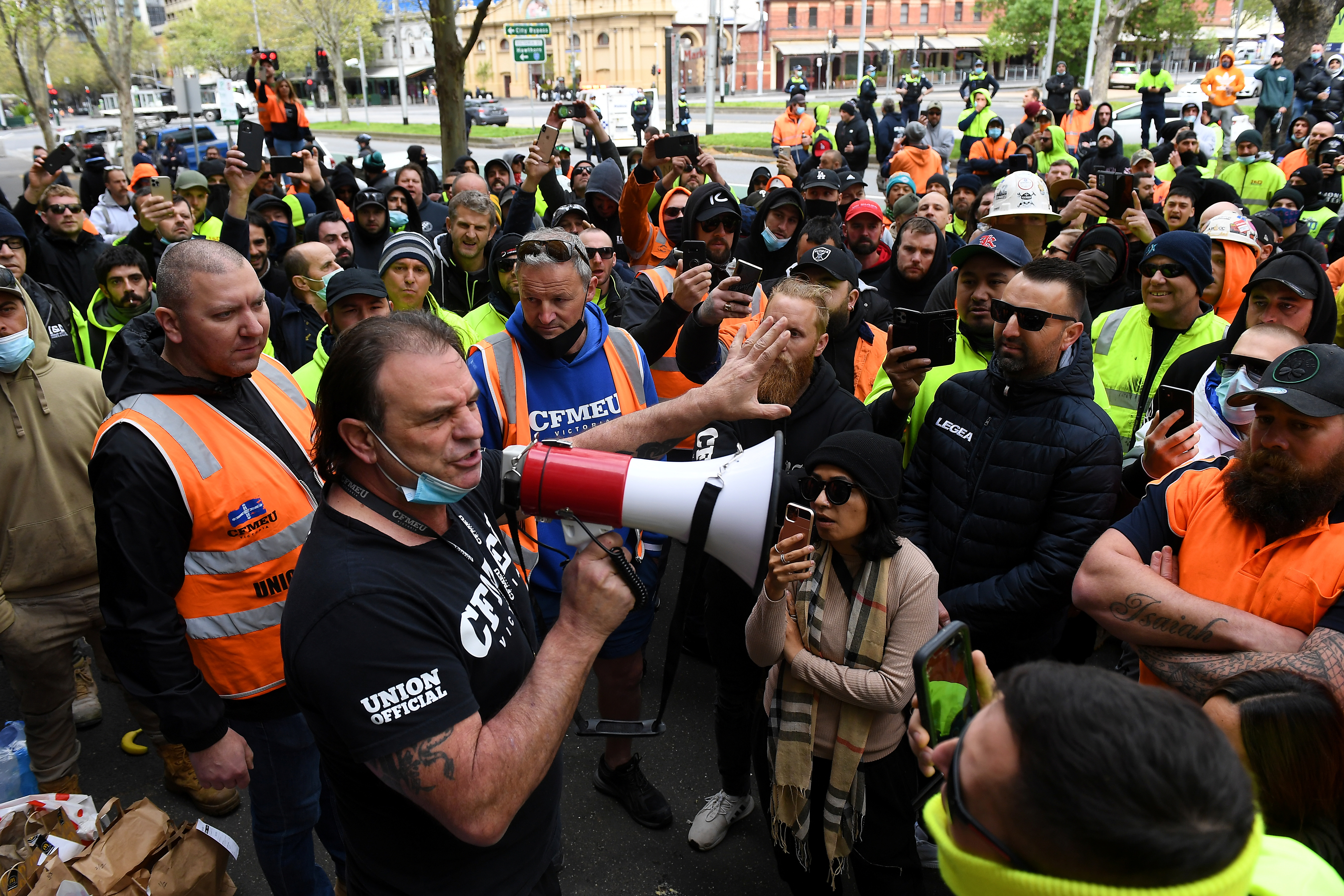 A unionist addresses construction workers protesting work-related coronavirus disease (COVID-19) restrictions at Construction, Forestry, Maritime, Mining and Energy Union (CFMEU) headquarters in Melbourne, Australia, September 20, 2021.  AAP Image/James Ross via REUTERS