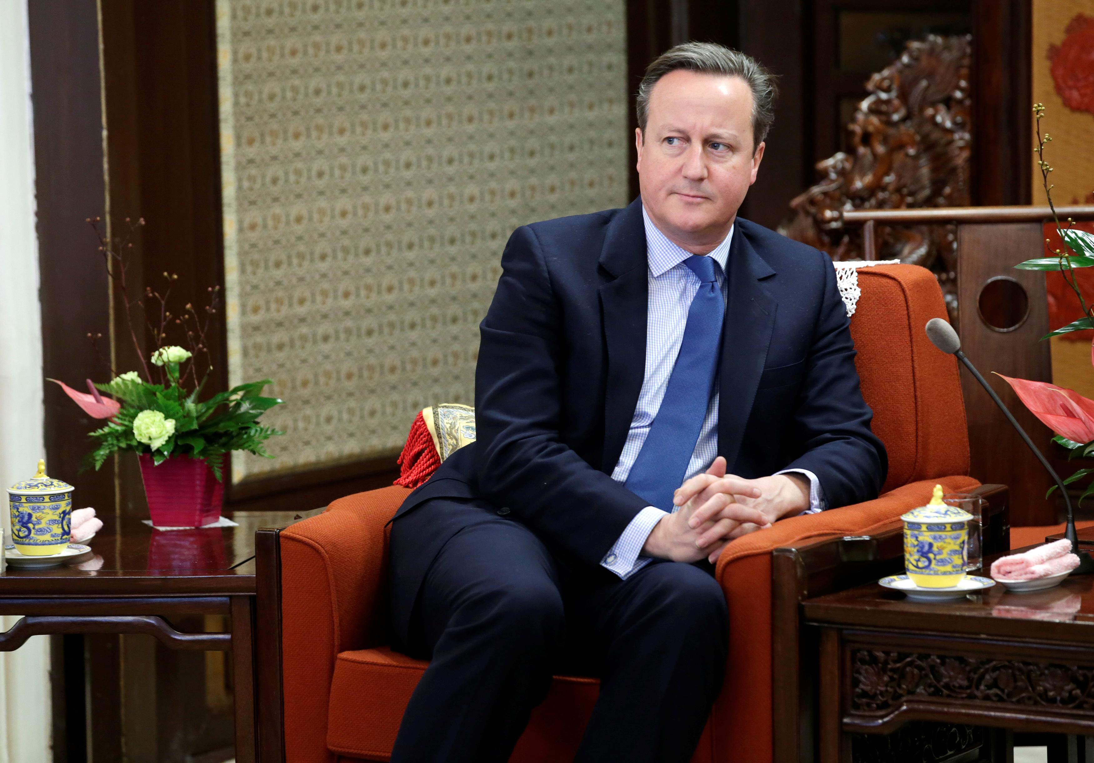 Former British Prime Minister David Cameron meets China's Premier Li Keqiang (not pictured) at Zhongnanhai leadership compound, in Beijing, China, November 27, 2018. REUTERS/Jason Lee/Pool