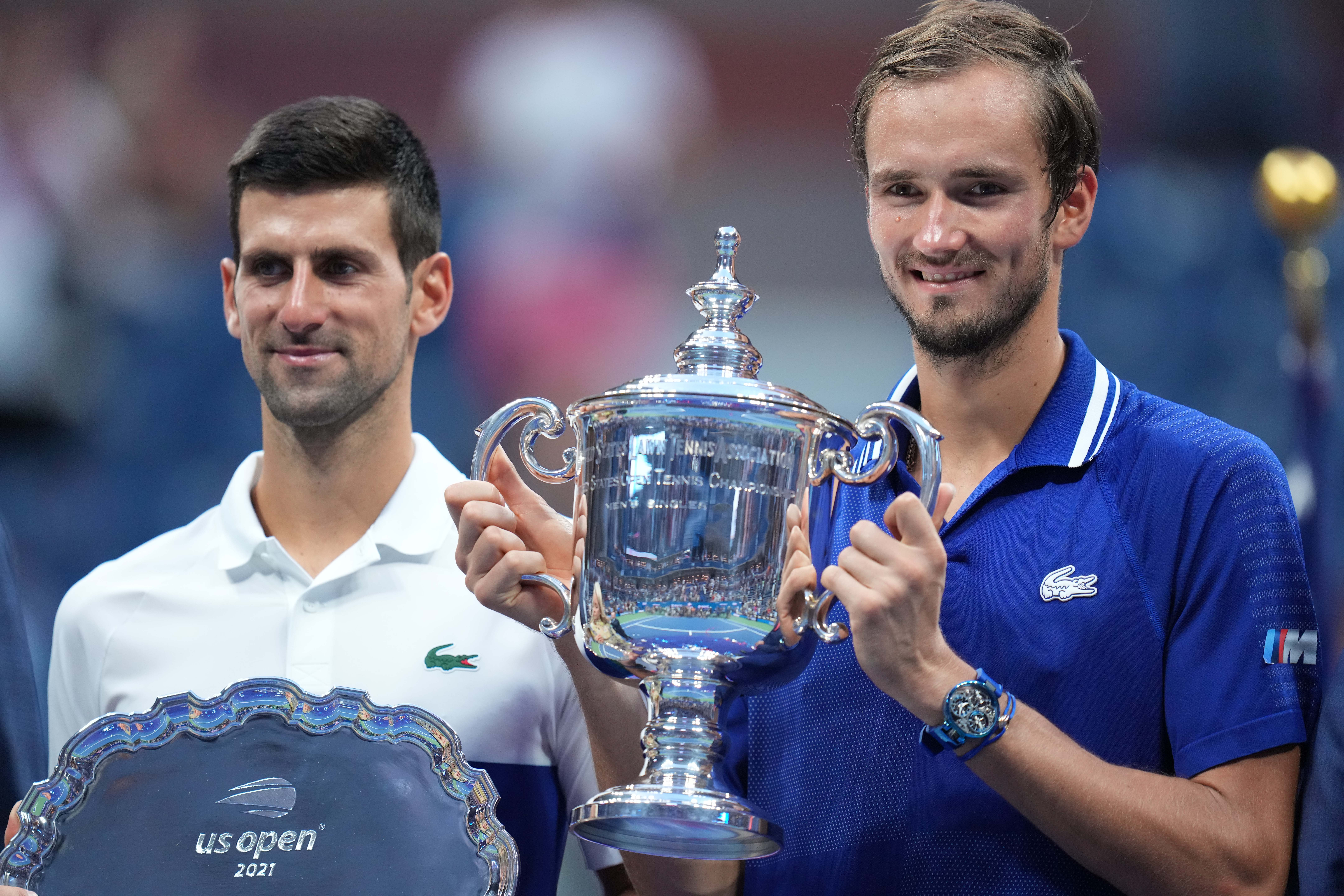 Sep 12, 2021; Flushing, NY, USA; (L-R) Novak Djokovic of Serbia and Daniil Medvedev of Russia celebrate with the finalist and championship trophies, respectively, after their match in the men's singles final on day fourteen of the 2021 U.S. Open tennis tournament at USTA Billie Jean King National Tennis Center. Mandatory Credit: Danielle Parhizkaran-USA TODAY Sports/File photo