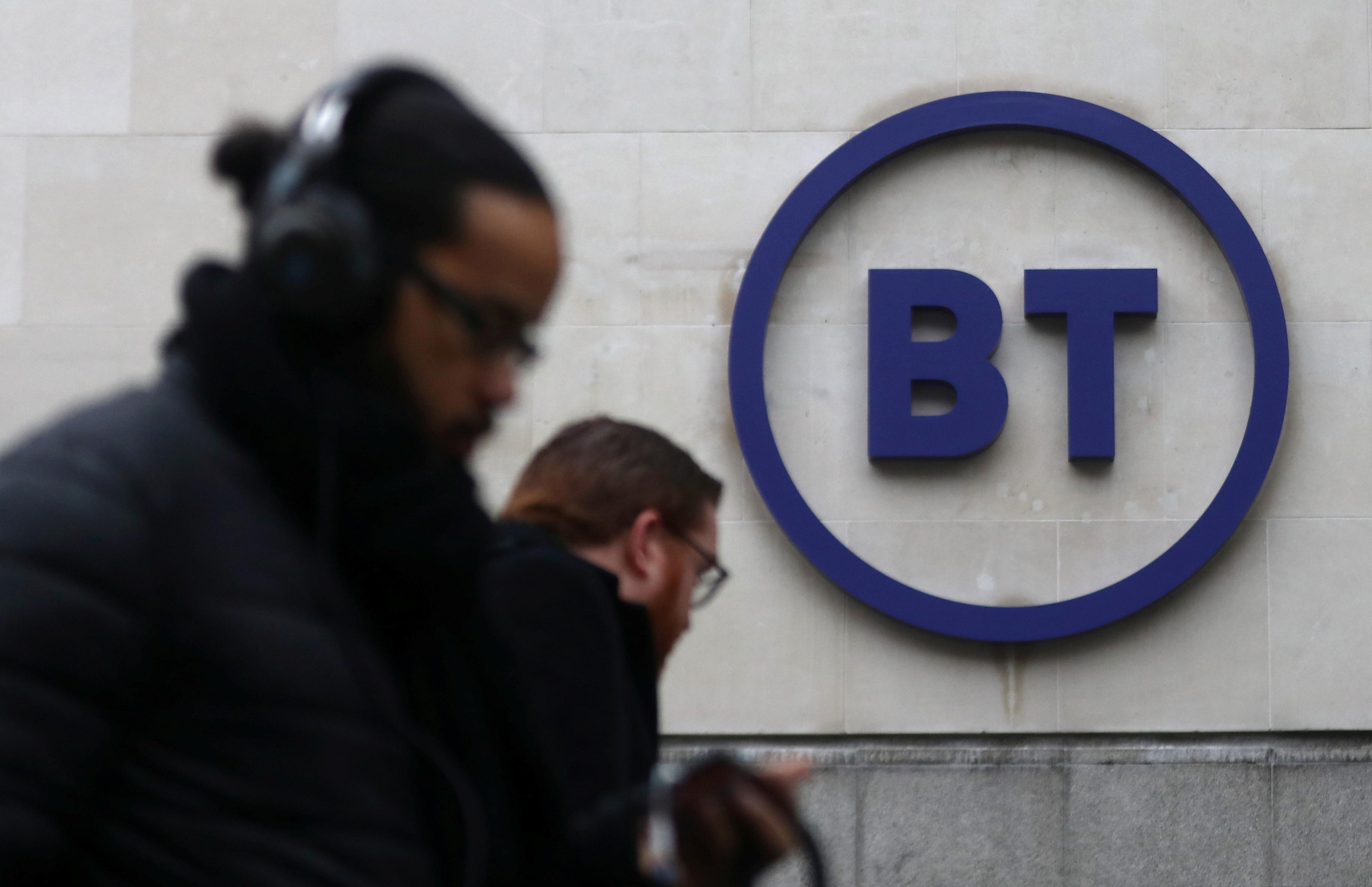 People walk past the BT headquarters in London, Britain, November 15, 2019. REUTERS/Simon Dawson