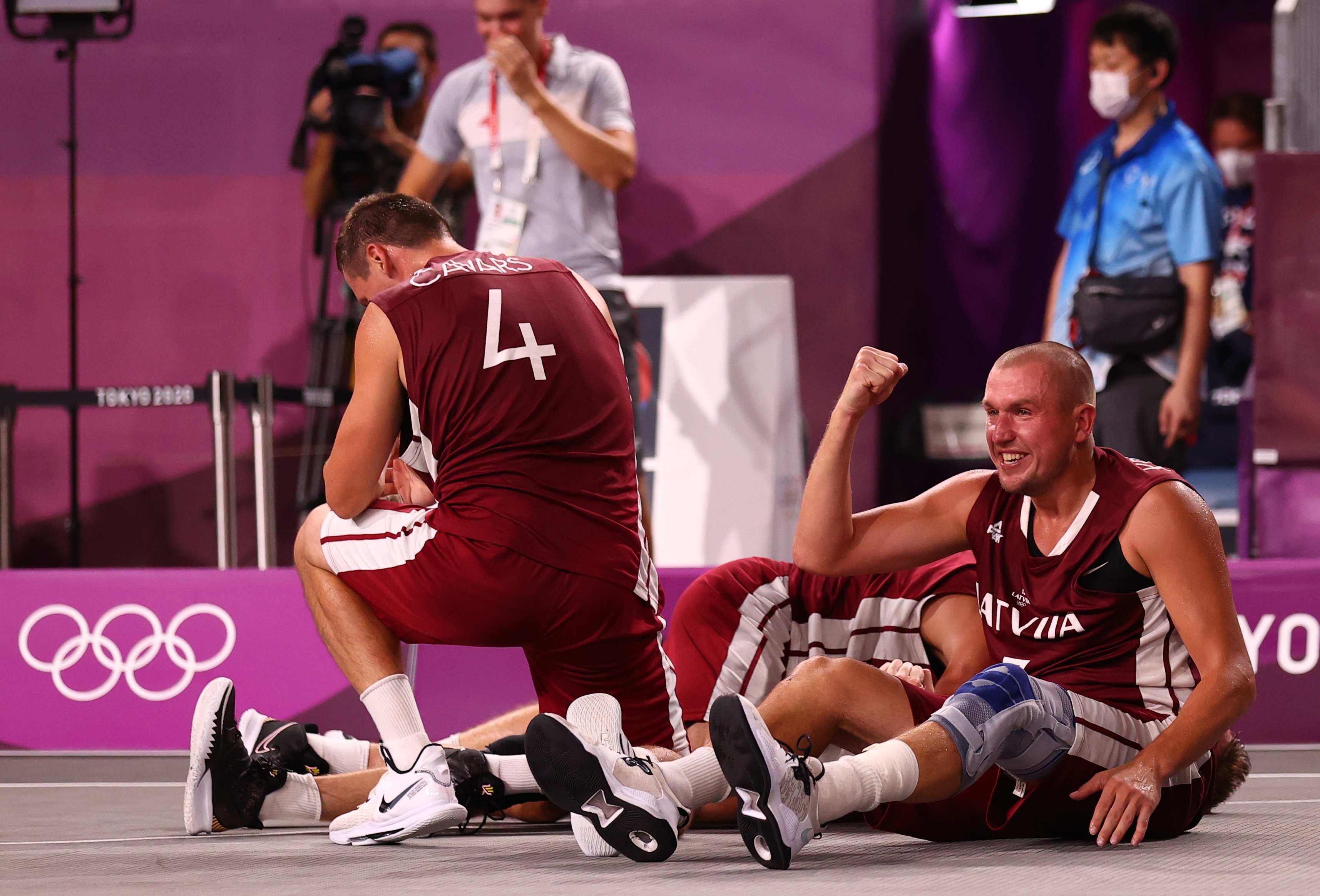 Tokyo 2020 Olympics - Basketball 3x3 - Men - Finals - The Russian Olympic Committee v Latvia - Aomi Urban Sports Park, Tokyo Japan - July 28, 2021. Players of Latvia celebrate victory after the match. REUTERS/Andrew Boyers