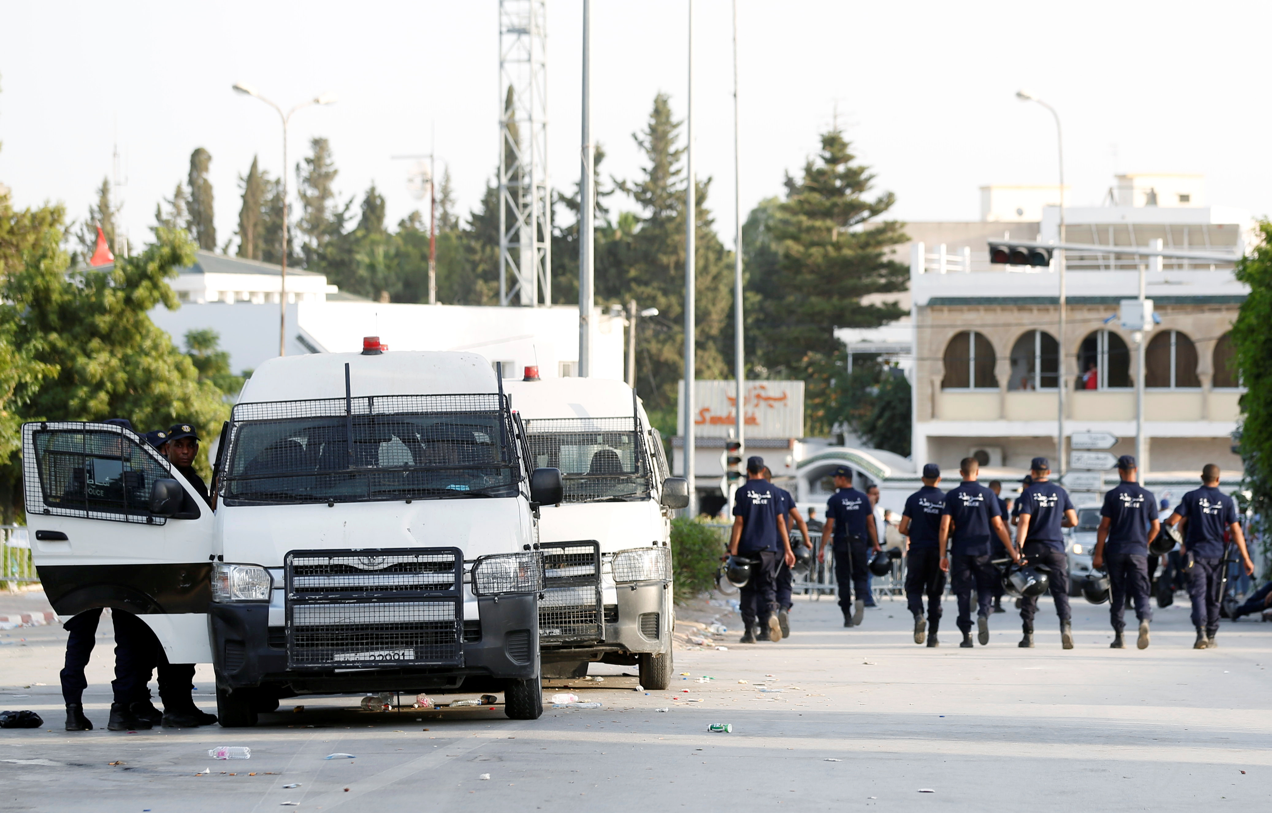 Police officers walk near the parliament building in Tunis, Tunisia  July 26, 2021. REUTERS/Zoubeir Souissi