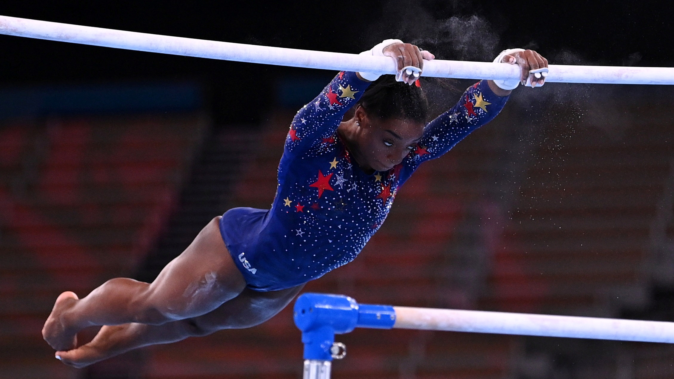 Tokyo 2020 Olympics - Gymnastics - Artistic - Women's Uneven Bars - Qualification - Ariake Gymnastics Centre, Tokyo, Japan - July 25, 2021. Simone Biles of the United States in action on the uneven bars. REUTERS/Dylan Martinez