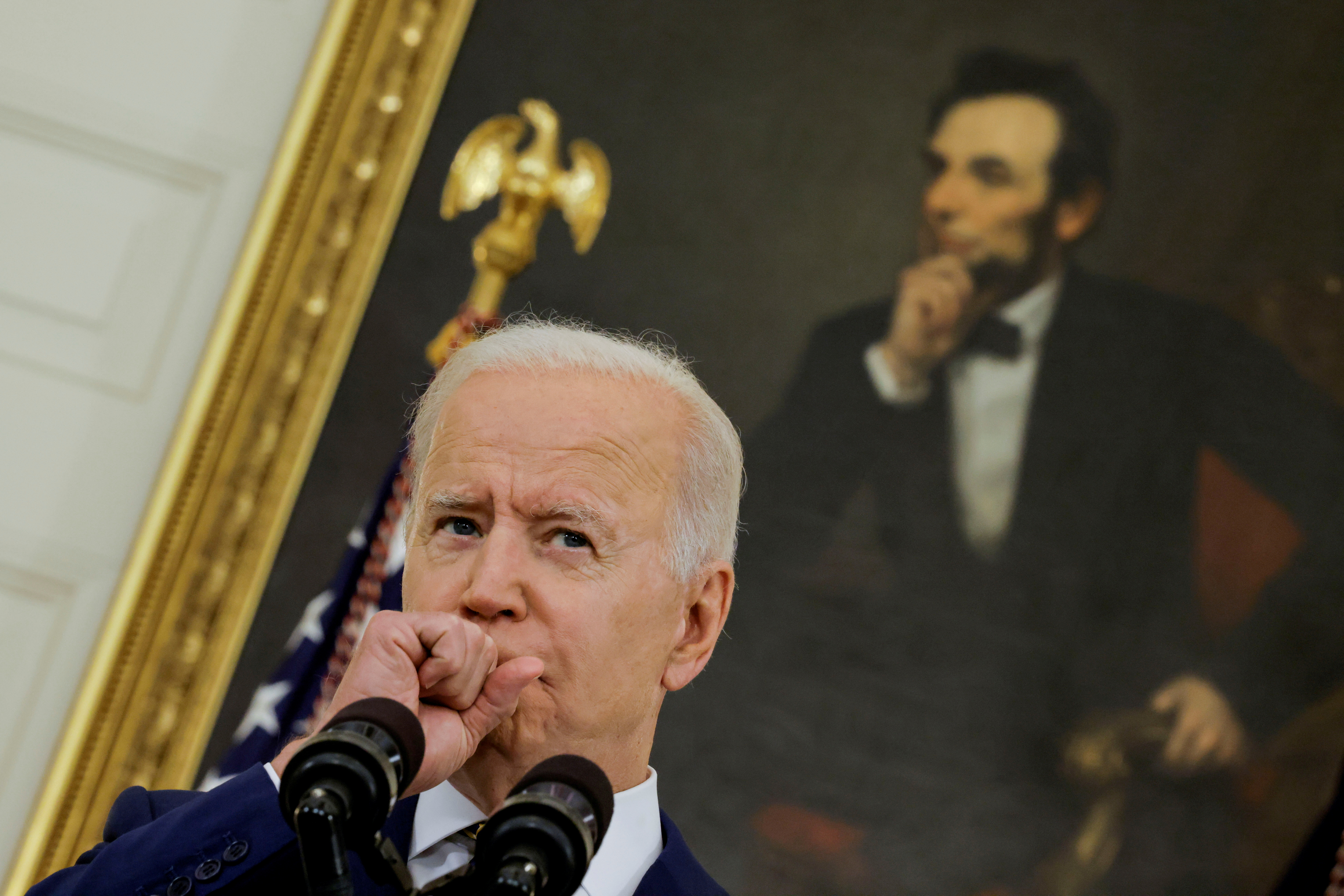 President Biden speaks about the administration's coronavirus disease response and the vaccination program during brief remarks in the State Dining Room of the White House in Washington, U.S., June 18, 2021. REUTERS/Carlos Barria/File Photo