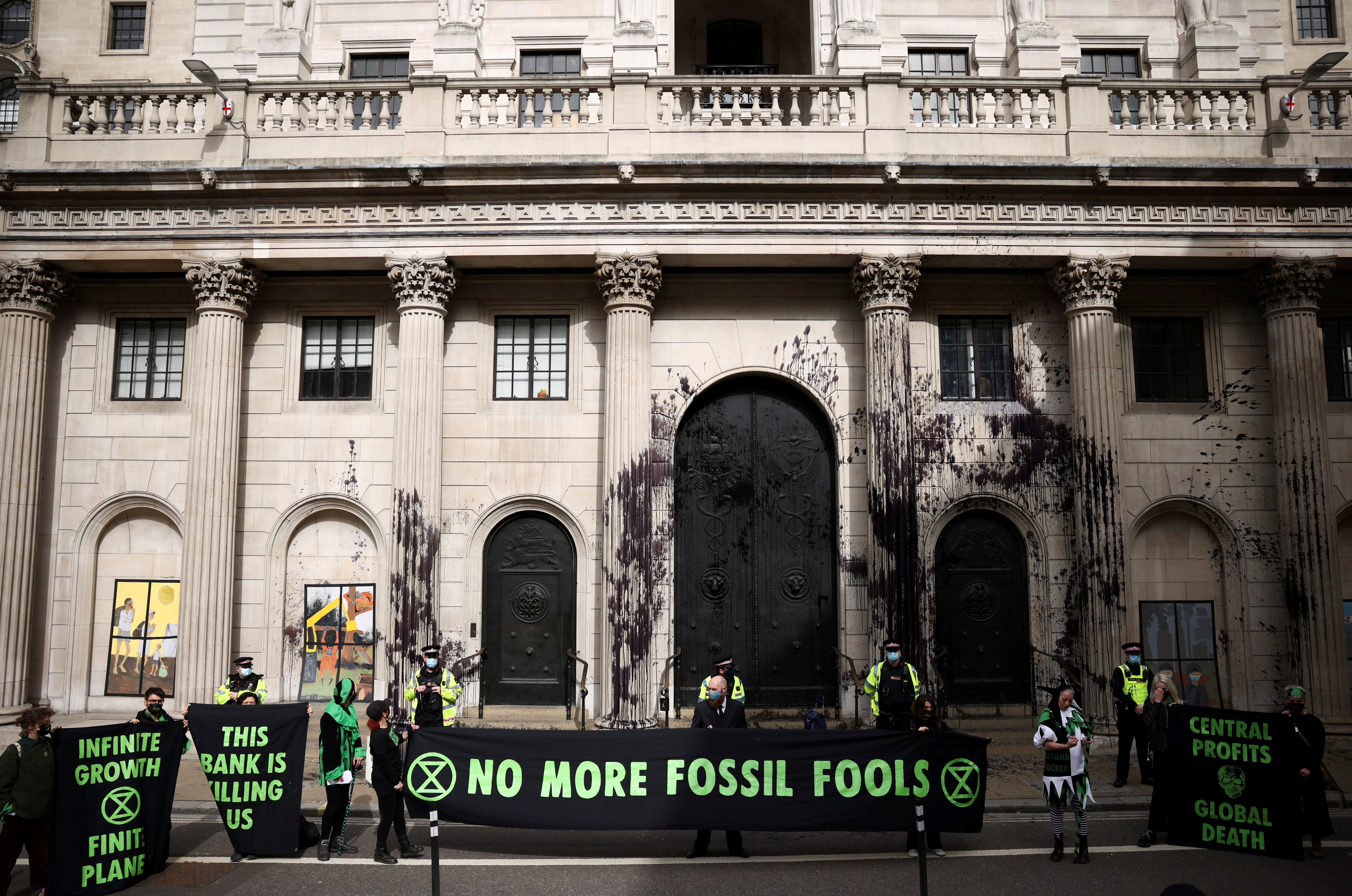 Activists from the Extinction Rebellion, a global environmental movement, protest outside the Bank of England, in London, Britain, April 1, 2021. REUTERS/Henry Nicholls