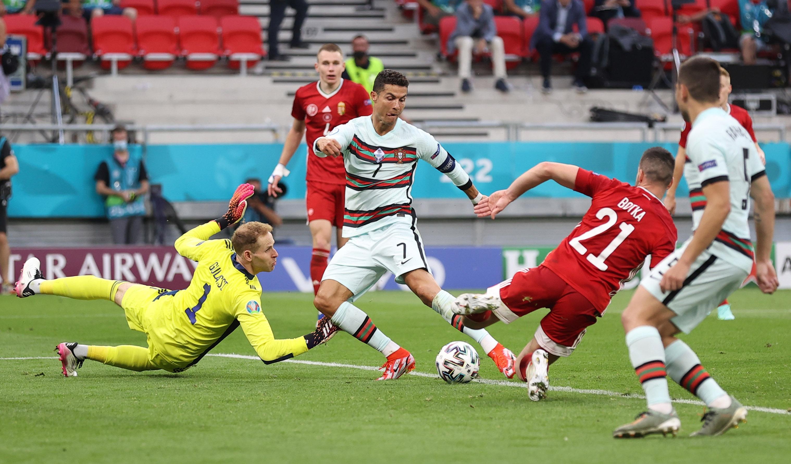 Soccer Football - Euro 2020 - Group F - Hungary v Portugal - Puskas Arena, Budapest, Hungary - June 15, 2021 Portugal's Cristiano Ronaldo scores their third goal Pool via REUTERS/Alex Pantling